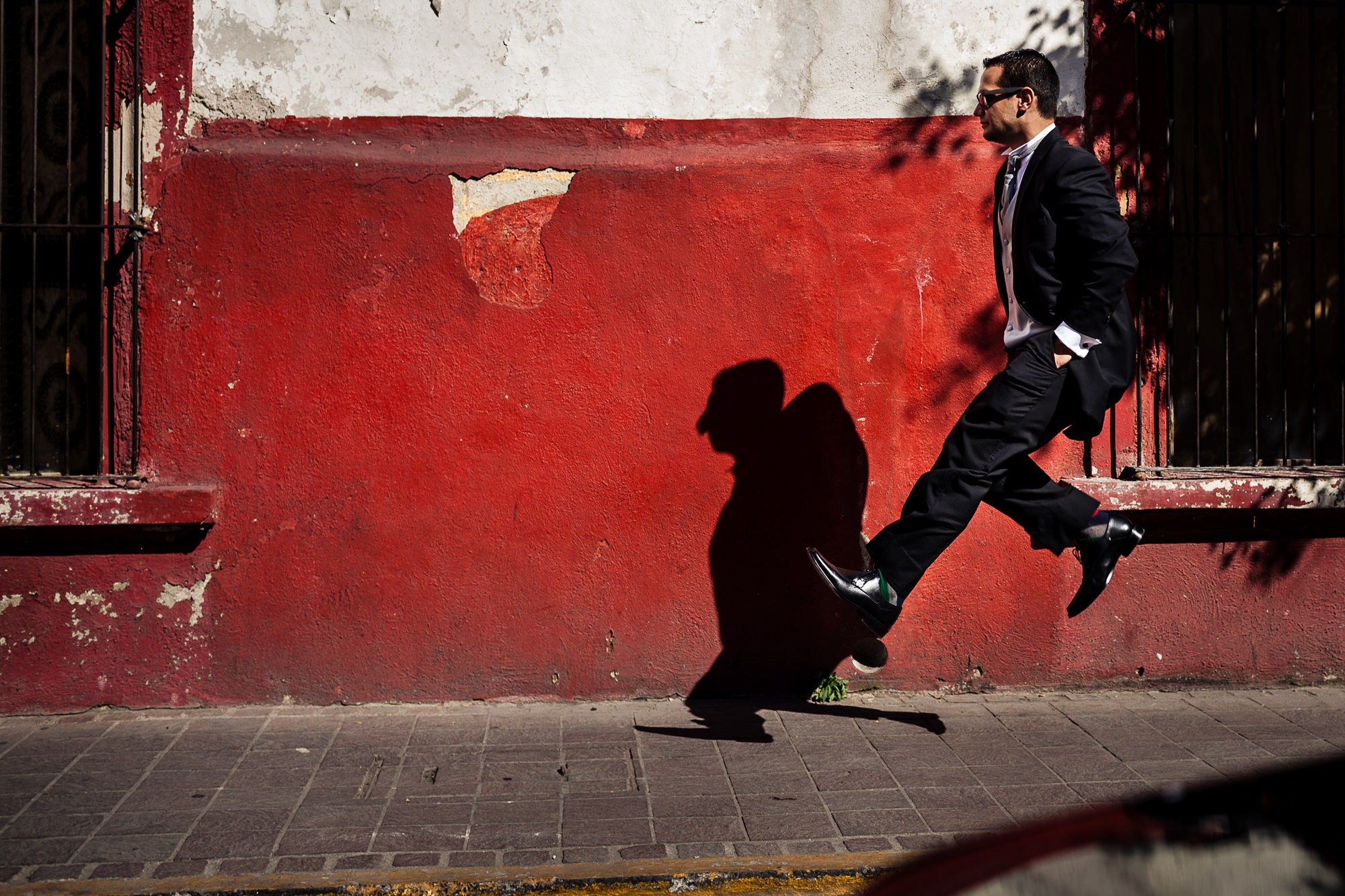 Groom in mid-air with shadow - photo by Jag Studios