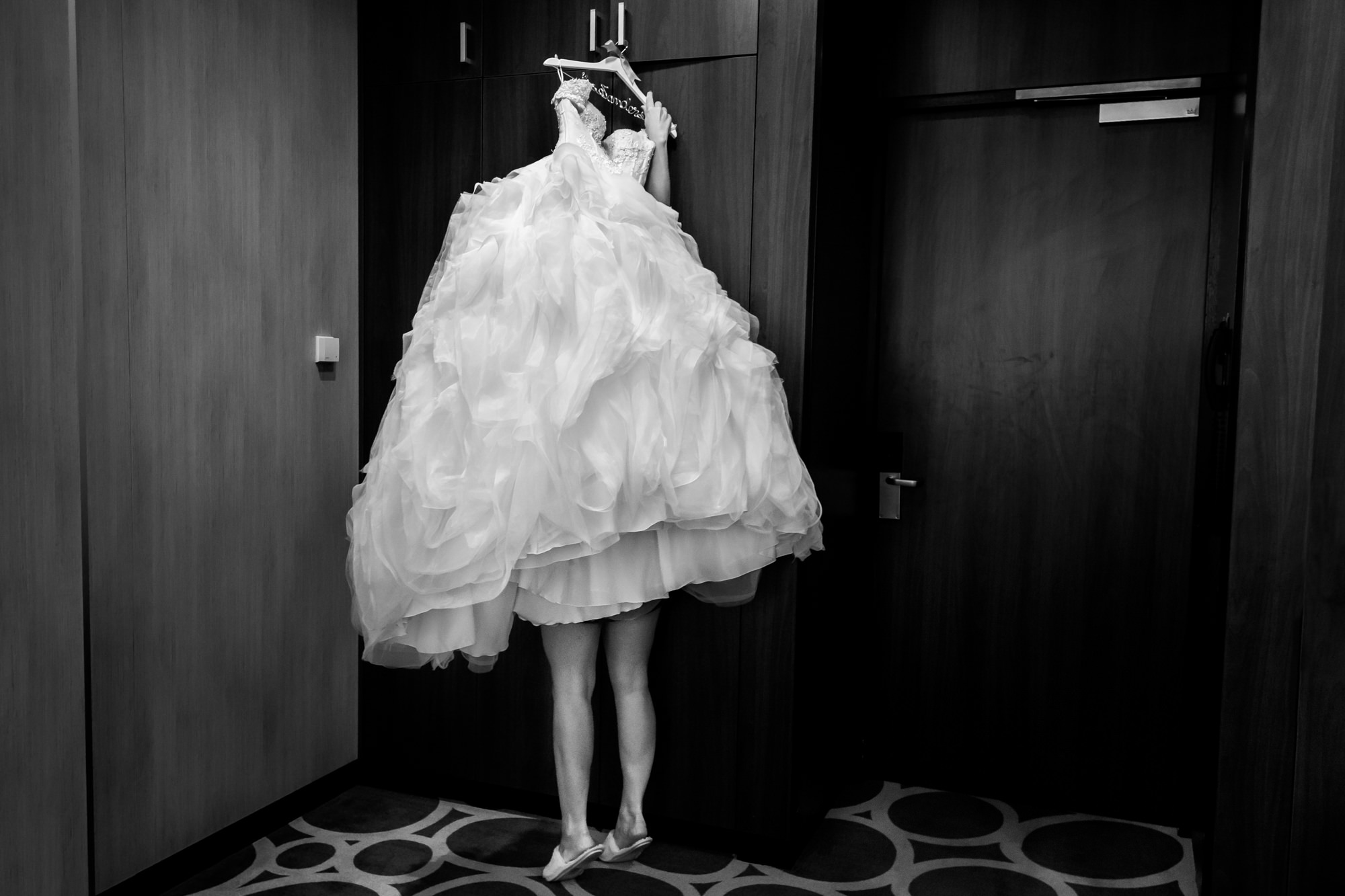 Funny image of bride under gown photo by Fotobelle: Isabelle Hattink