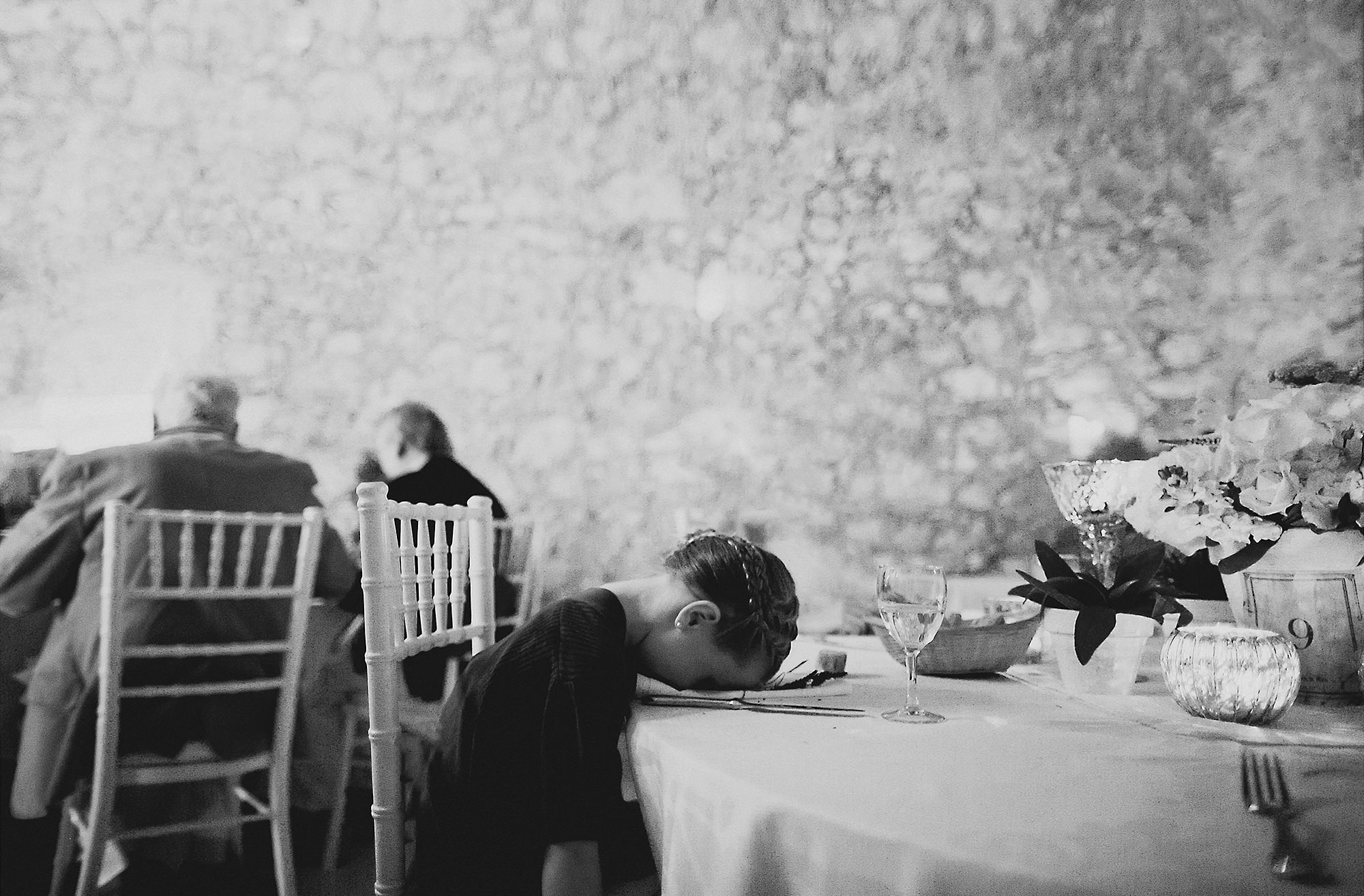 Funny child napping on placesetting - photo by Dan O'Day