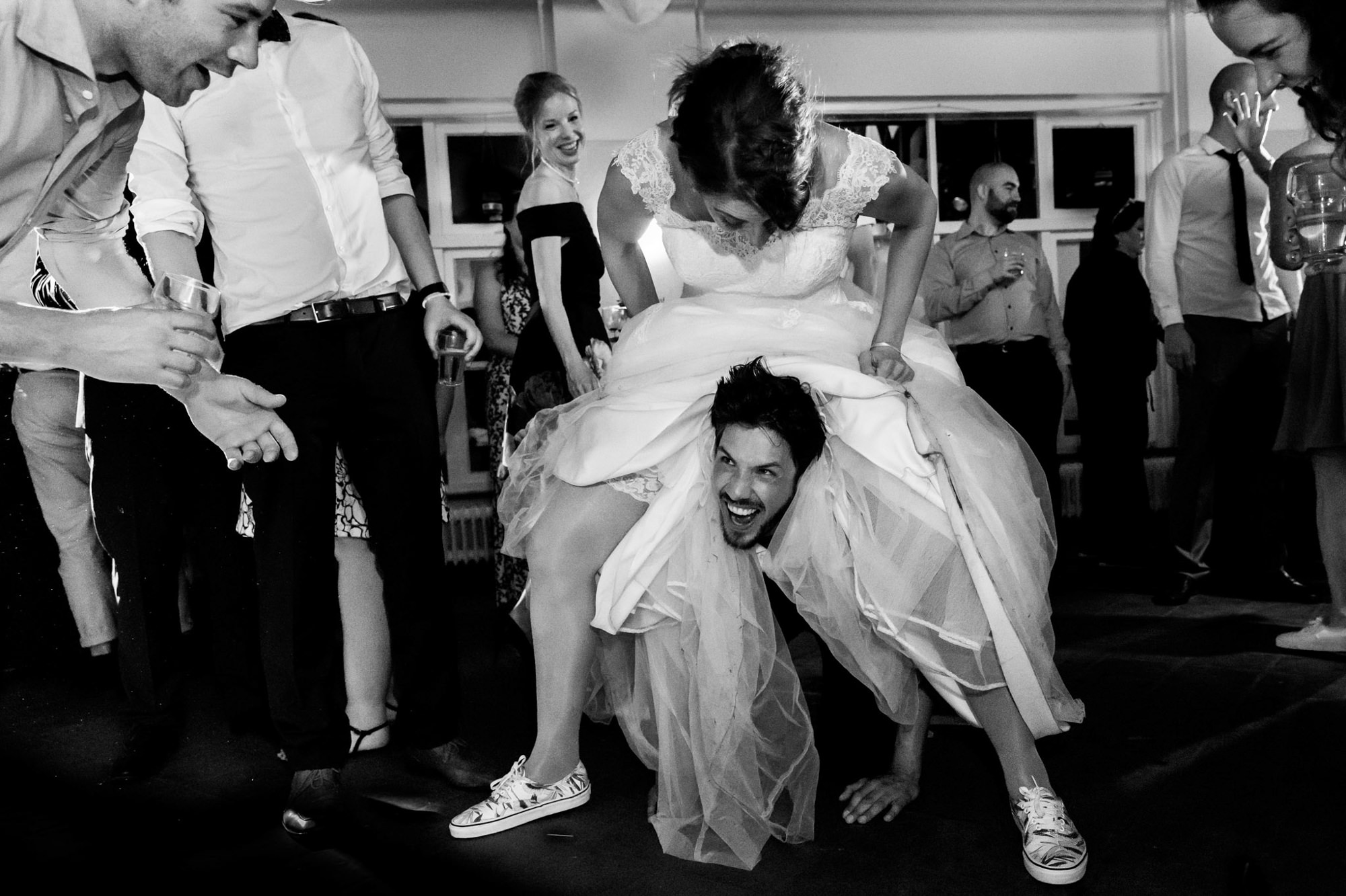 Bride astride groom on dance floor photo by Fotobelle: Isabelle Hattink