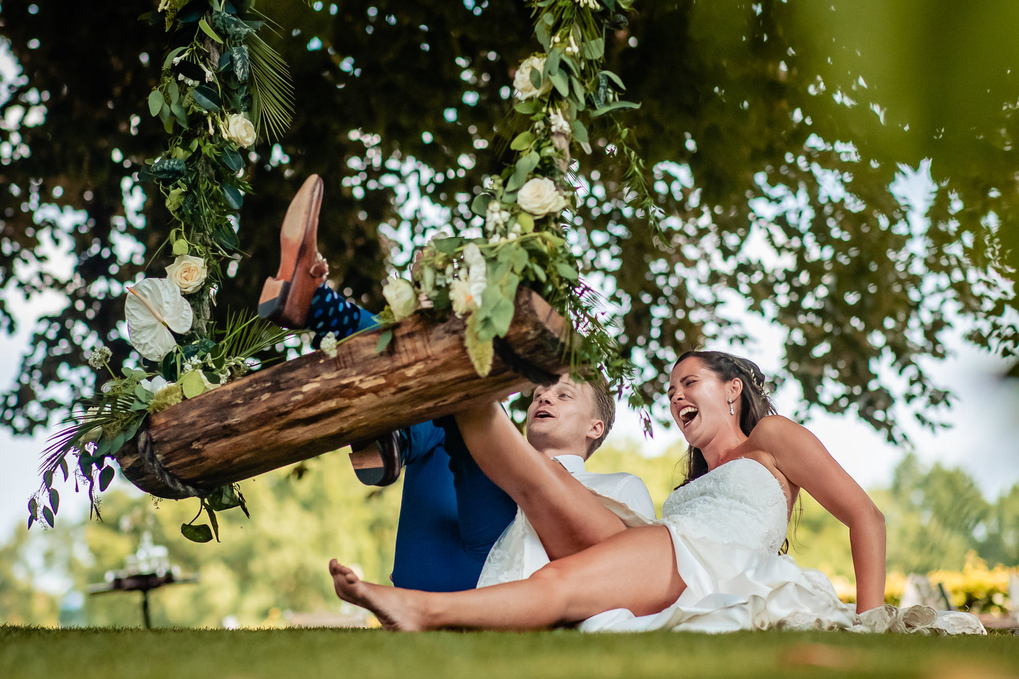 Couple falling off swing laughing photo by Eppel Photography