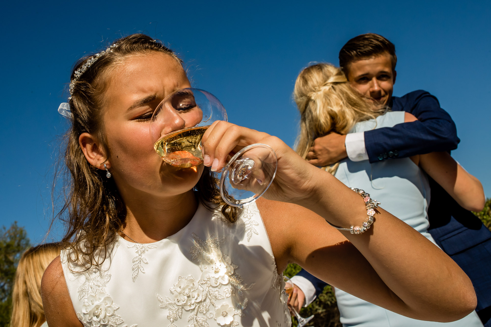 Young bridesmaid drinking champagne - photo by Eppel Photography