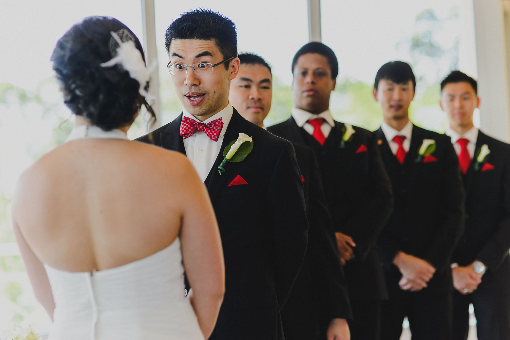 Funny reaction from groom during wedding ceremony, photo by The Brenizers