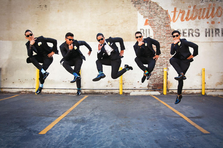 Fun photo of groomsmen posing  in mid air jump by Callaway Gable