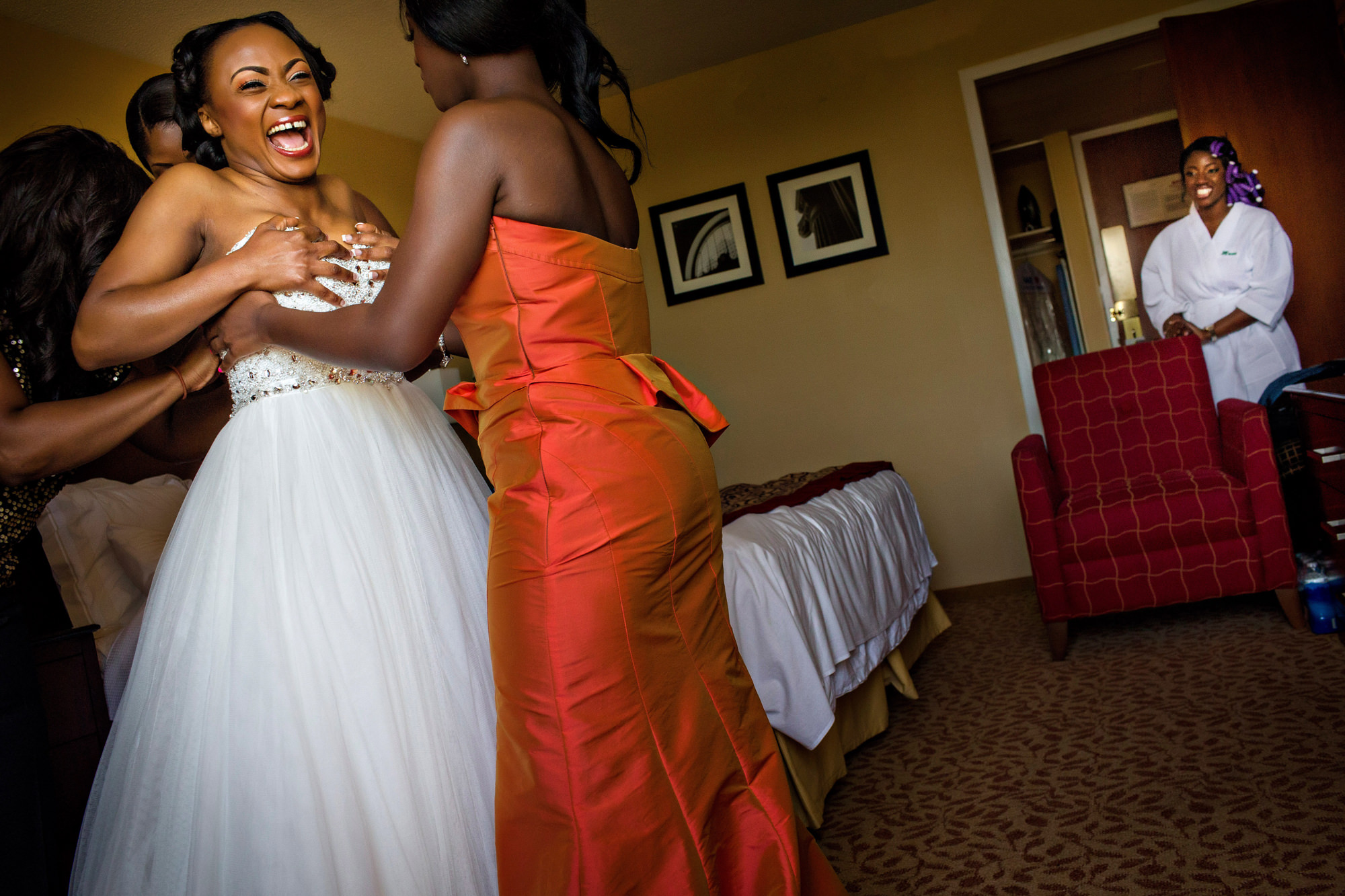 Laughing bride getting ready - photo by Alakija Studios