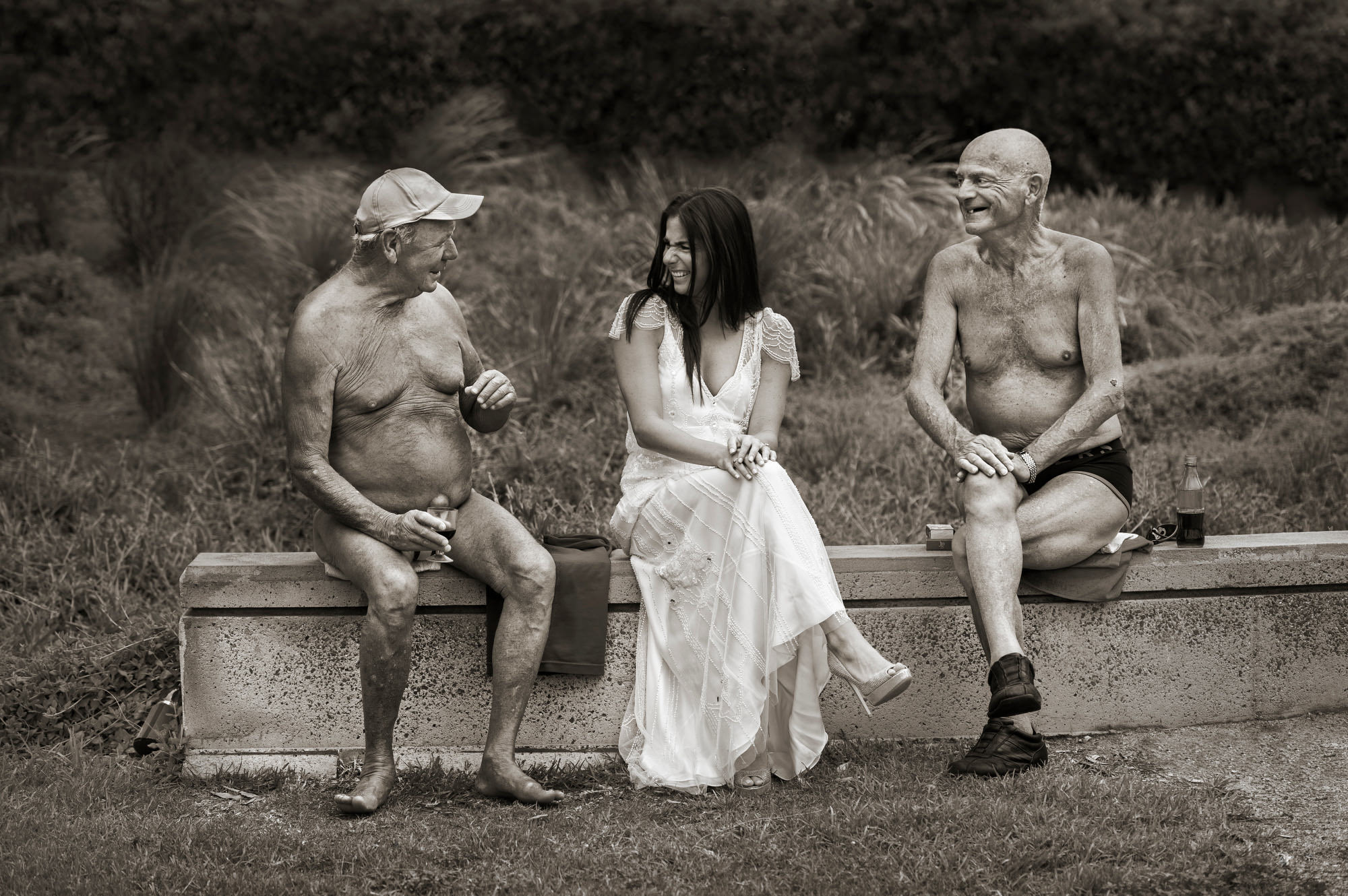 Funny old men in swim wear with bride photo by Jerry Ghionis
