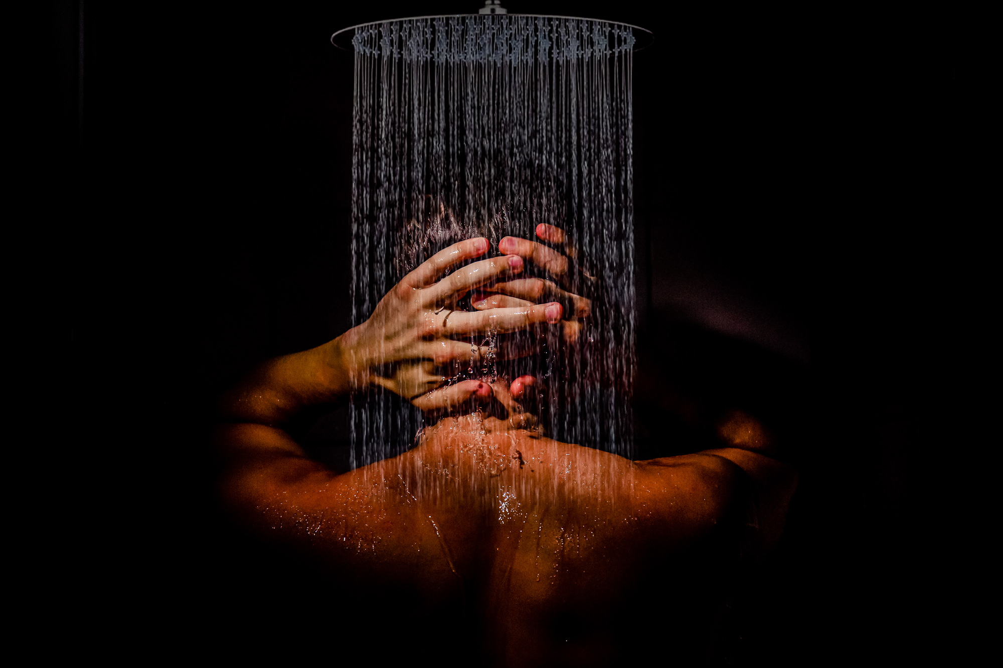Creative photo of groom in shower -  photo by Eppel Photography