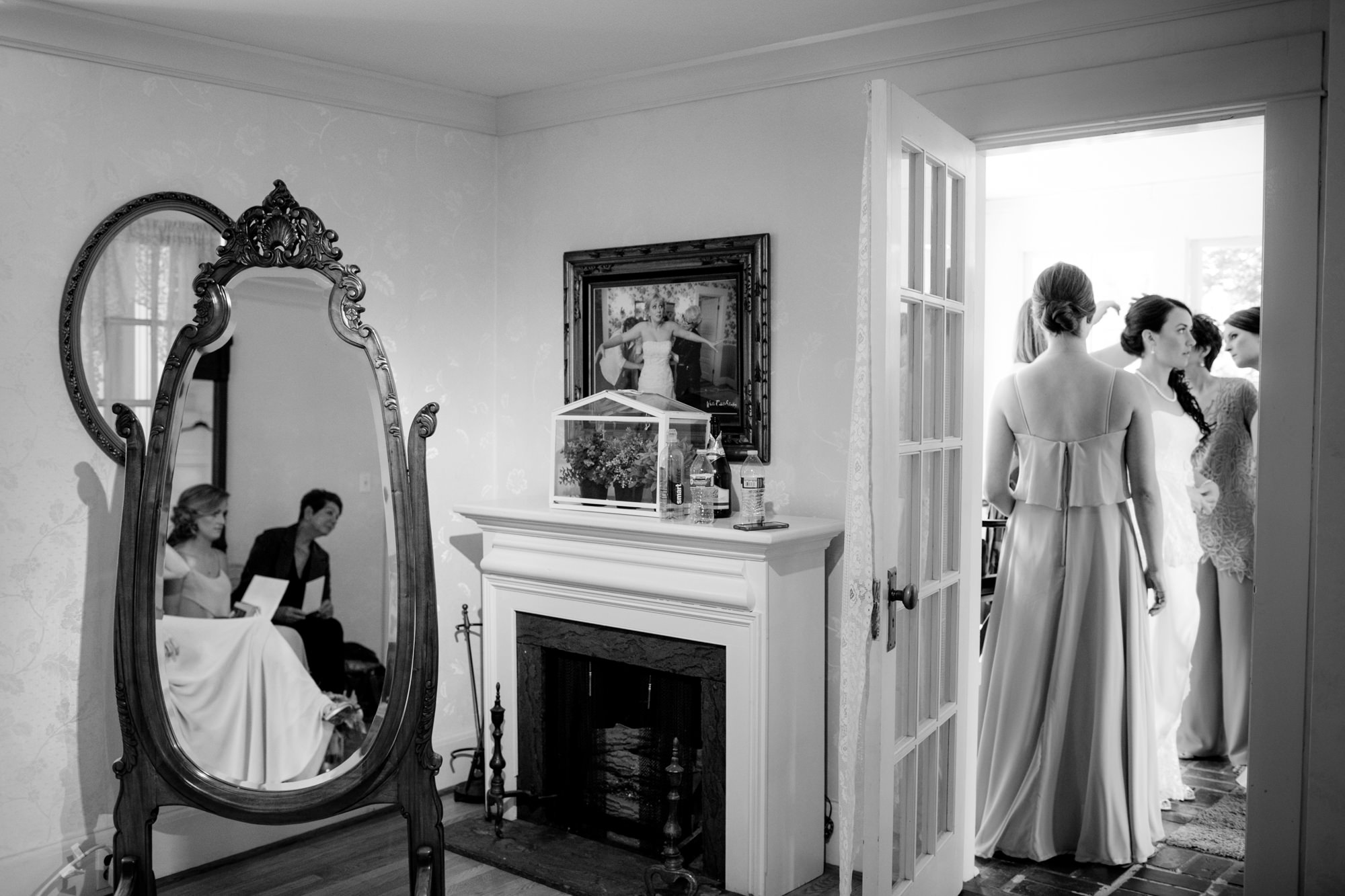 Look closer - photo of bride getting ready reflected in mirror above fireplace - Jessica Hill Photography