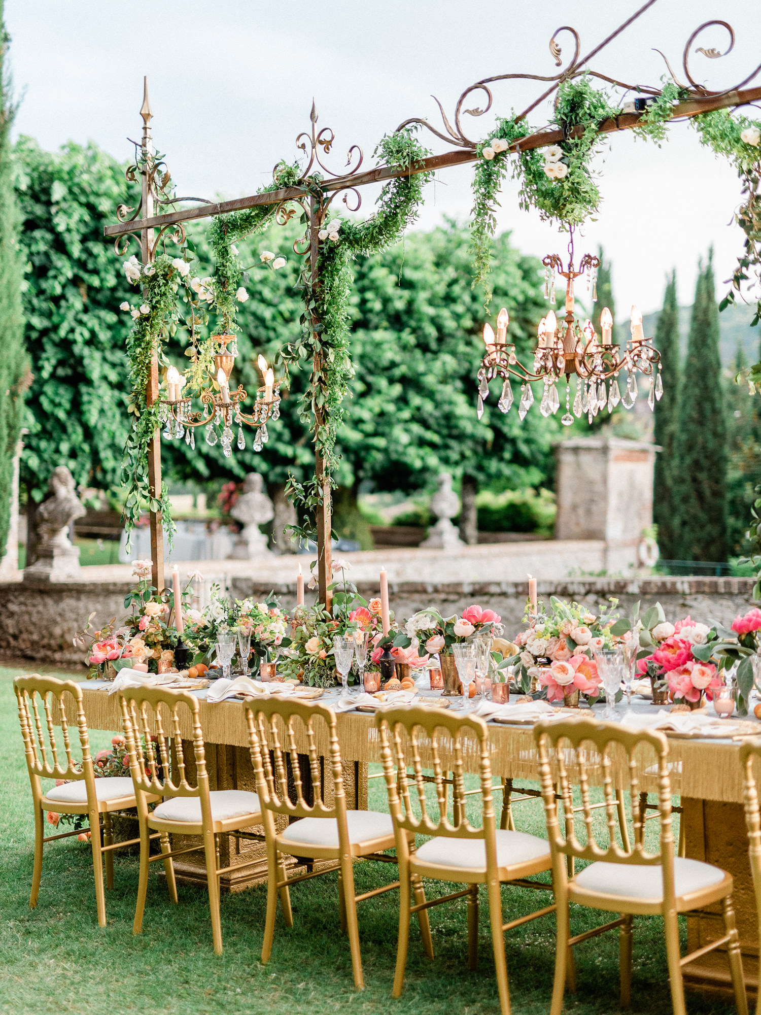 Elegant reception decor with gold chairs and chandeliers - photo by Gianluca Adoviaso Photography