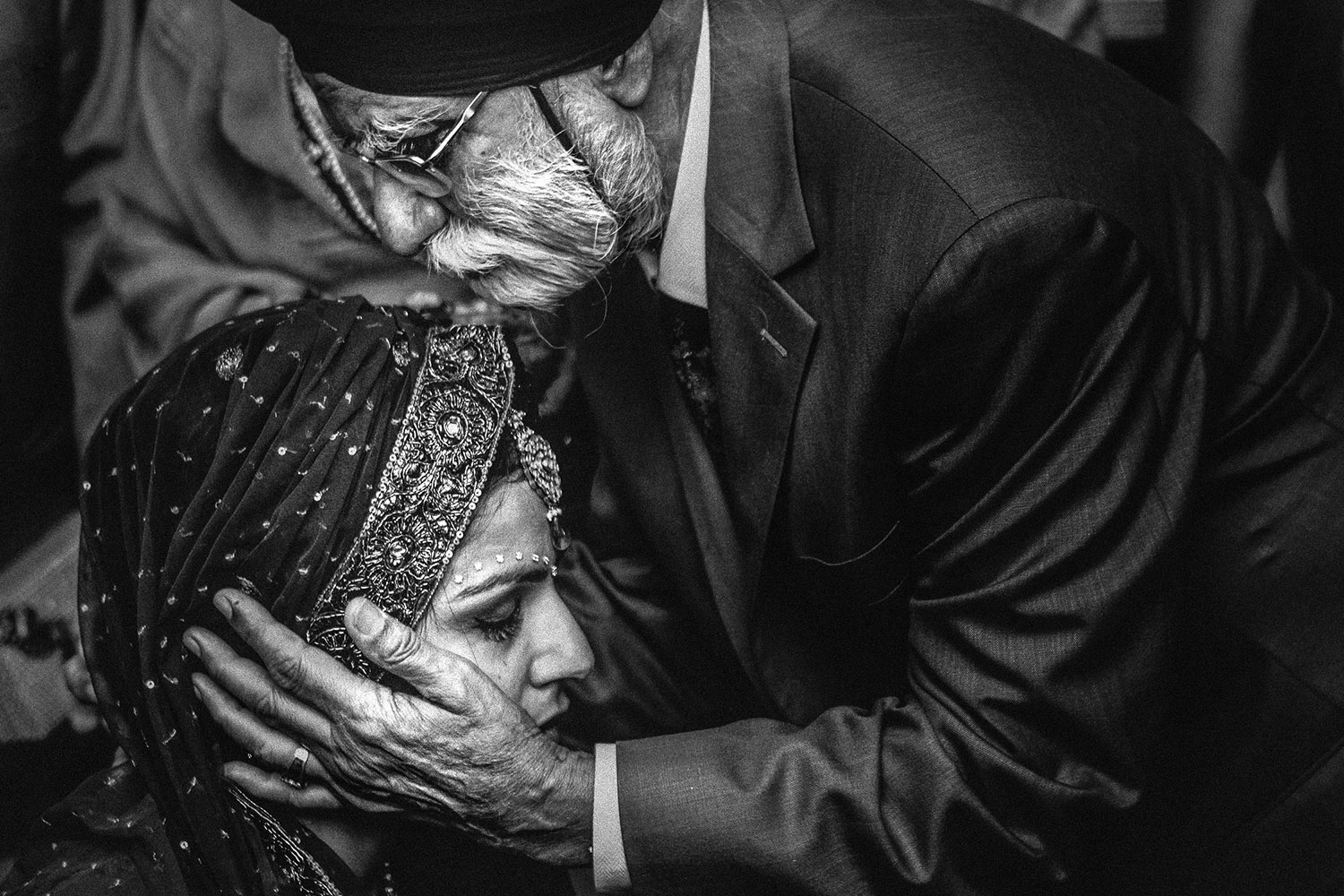 Sikh dad embracing bride, by Callaway Gable