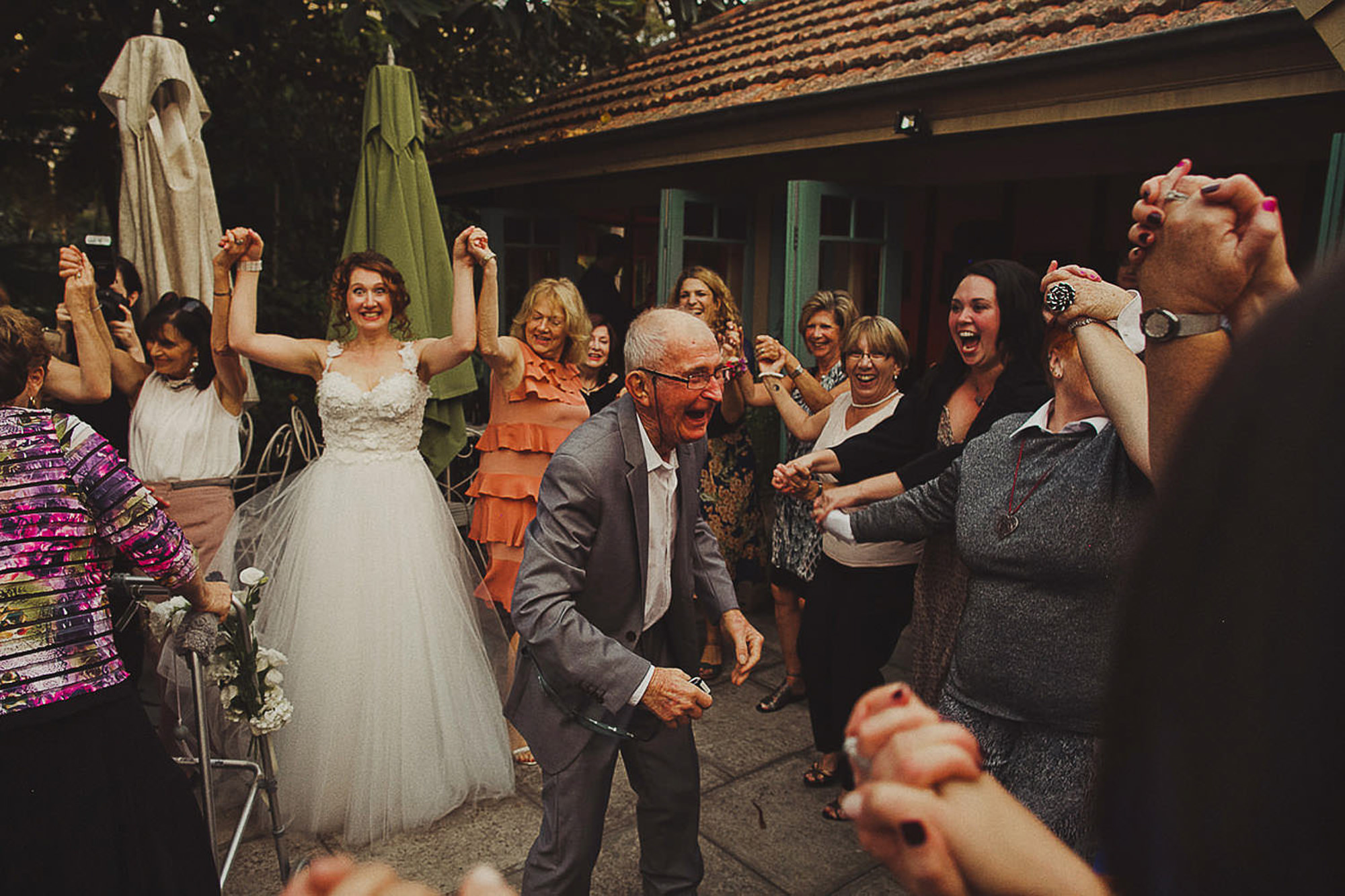 Grandpa dancing with bride in background - photo by Dan O'Day