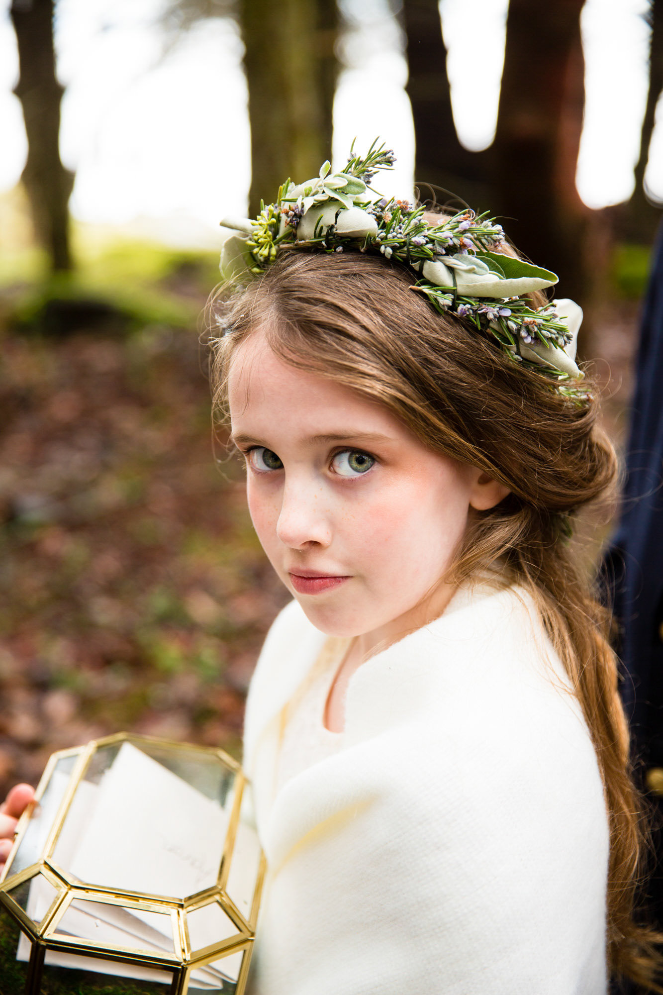 Green-eyed flower girl wearing floral crown - La Vie Photography