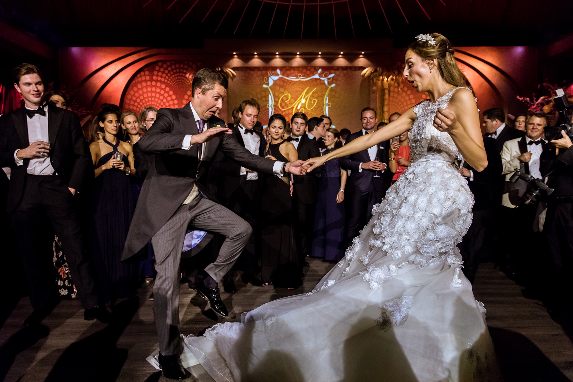 Dancing groom avoids stepping on bride's beautiful applique gown during dance photo by Fotobelle: Isabelle Hattink