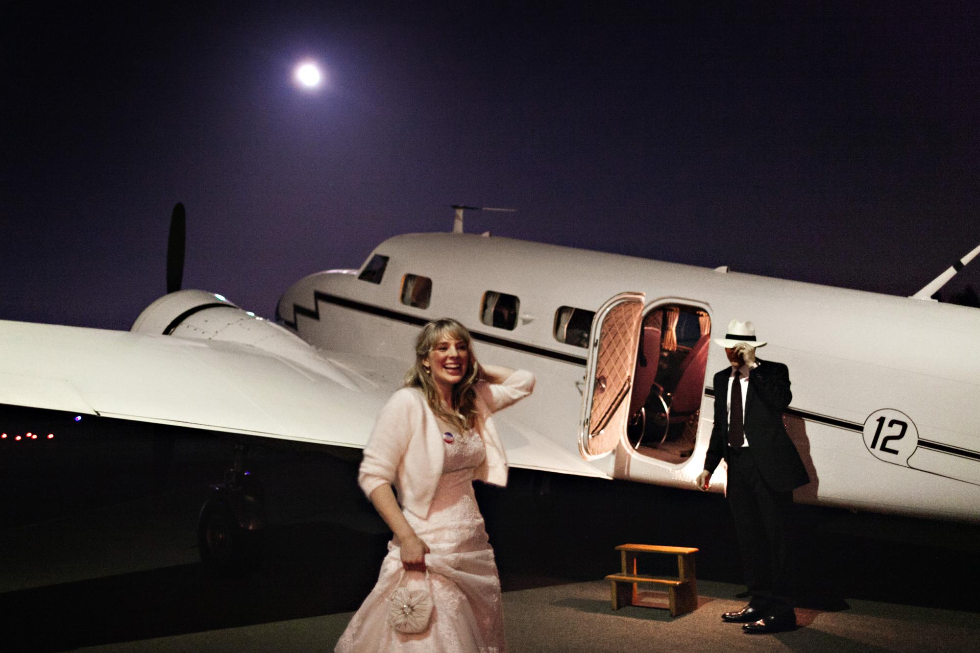 Groom awaits bride in vintage plane - PhotoJJ
