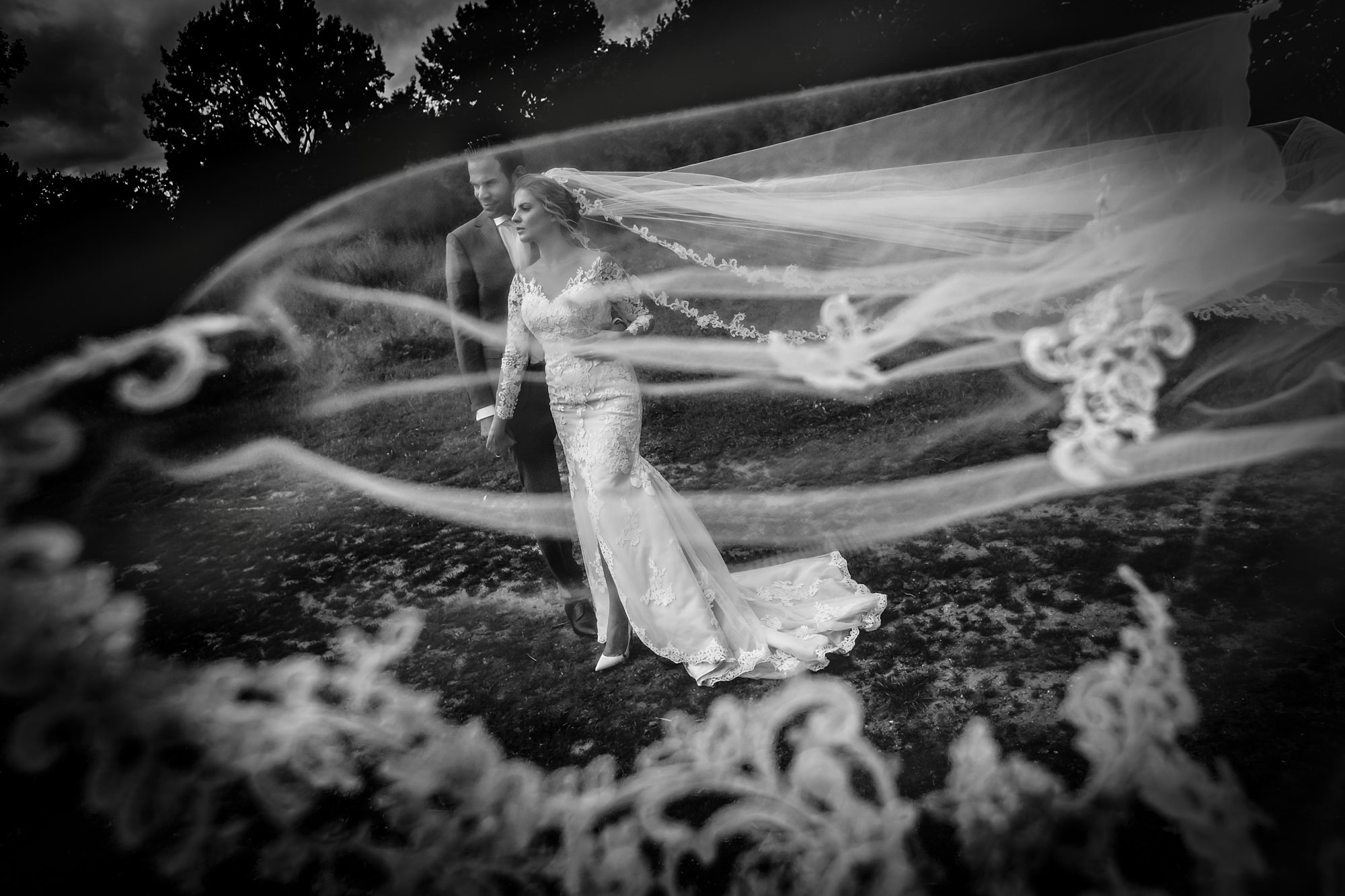 Bride and groom surrounded by swirling veil by Eppel Photography