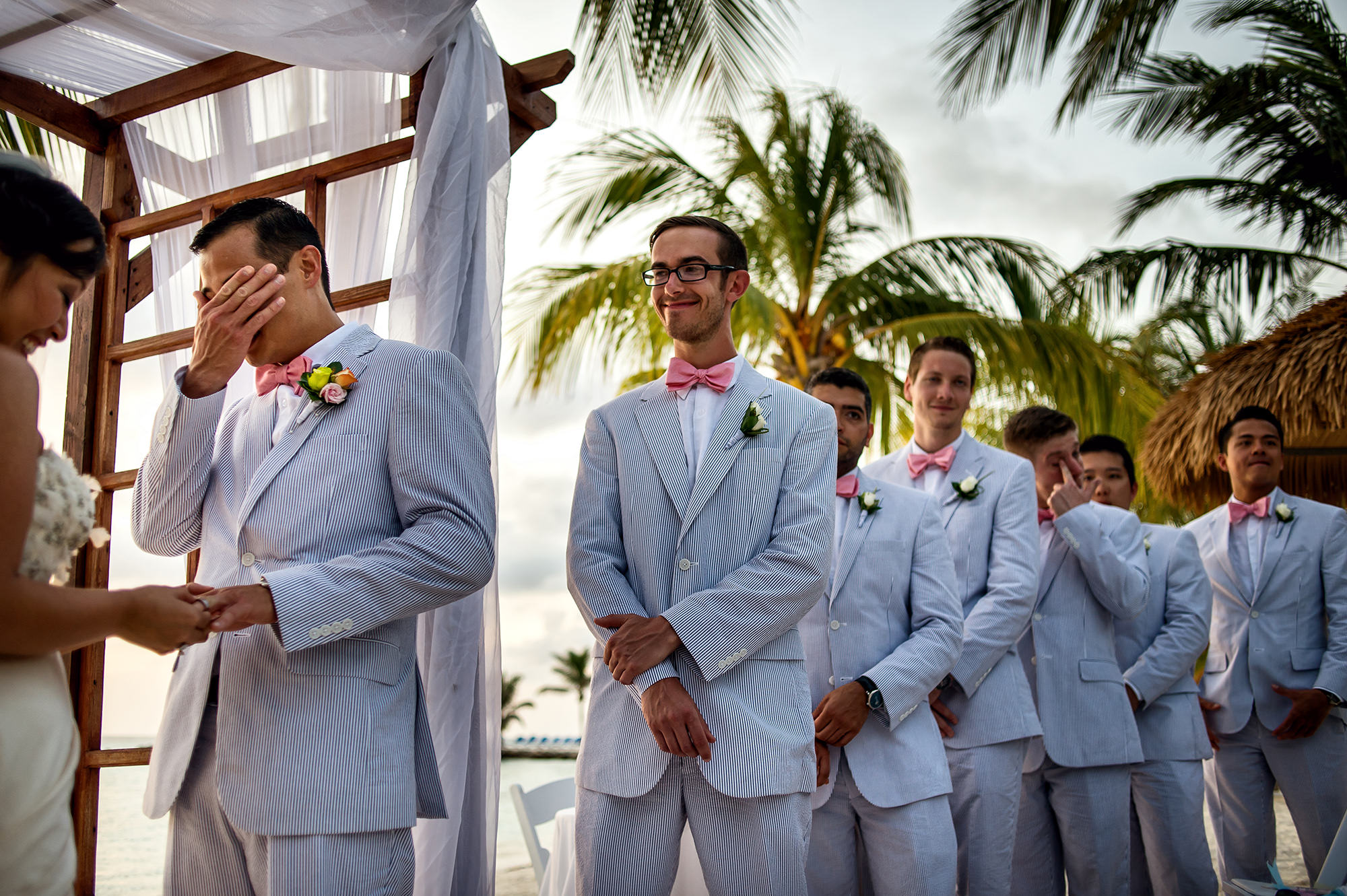 Tearful groom at ceremony with groomsmen- photo by Davina + Daniel