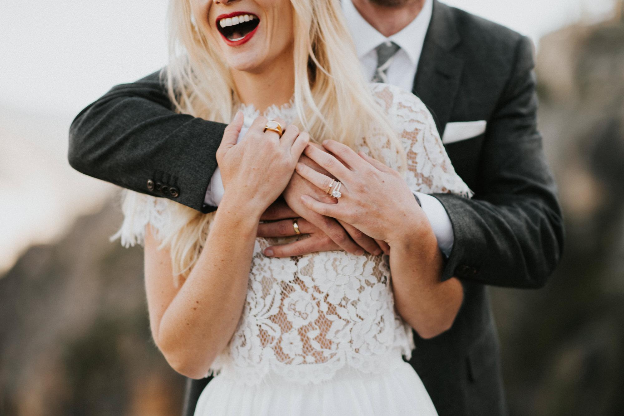 Groom embraces bride - Nick + Danee