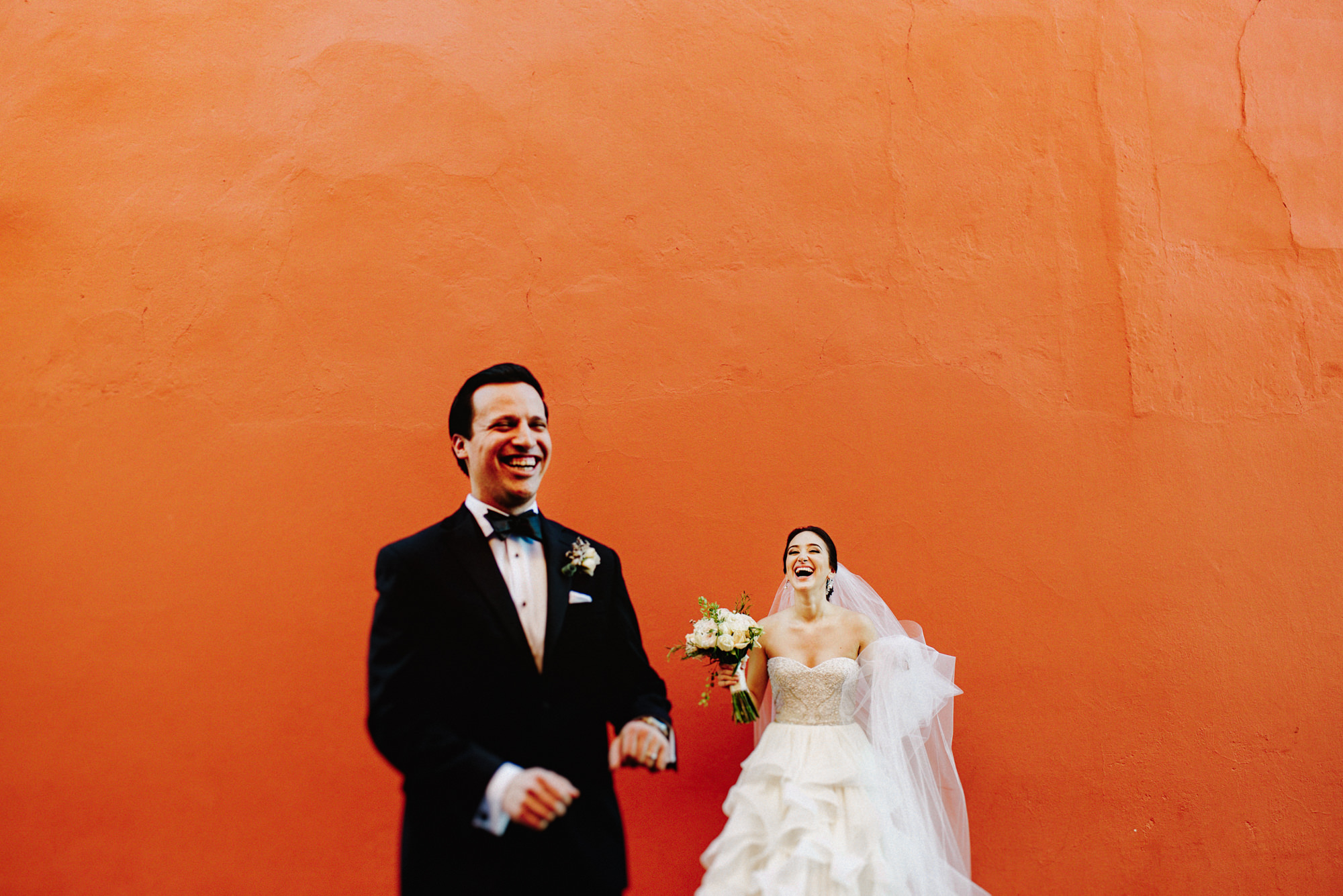 Happy photo of groom and bride in ruffled strapless gown