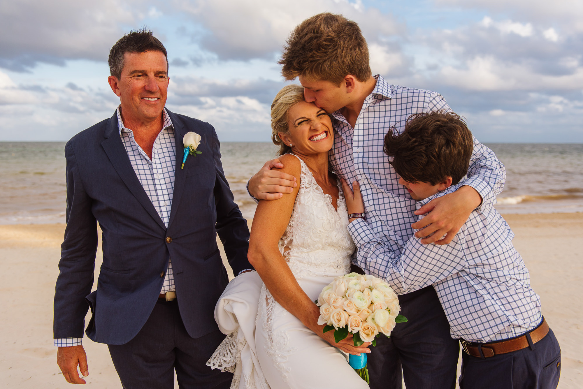 Bride's stepsons give her a kiss after ceremony, by Citlalli Rico