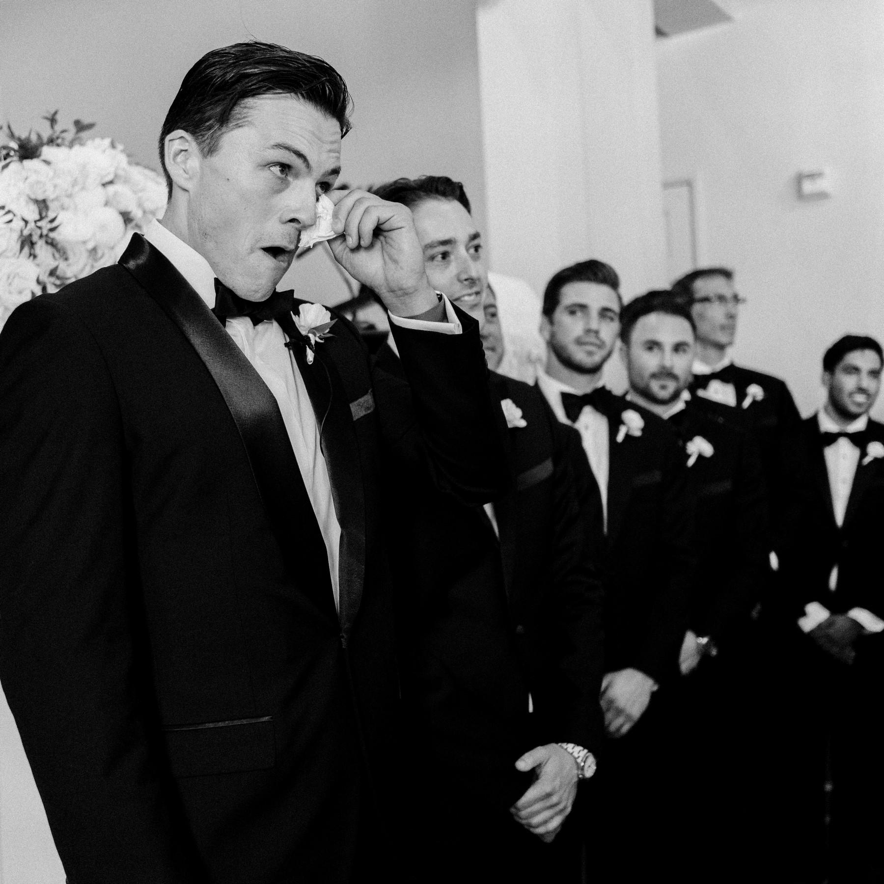 Leonardo Dicaprio wipes his eye during ceremony - photo by John and Joseph