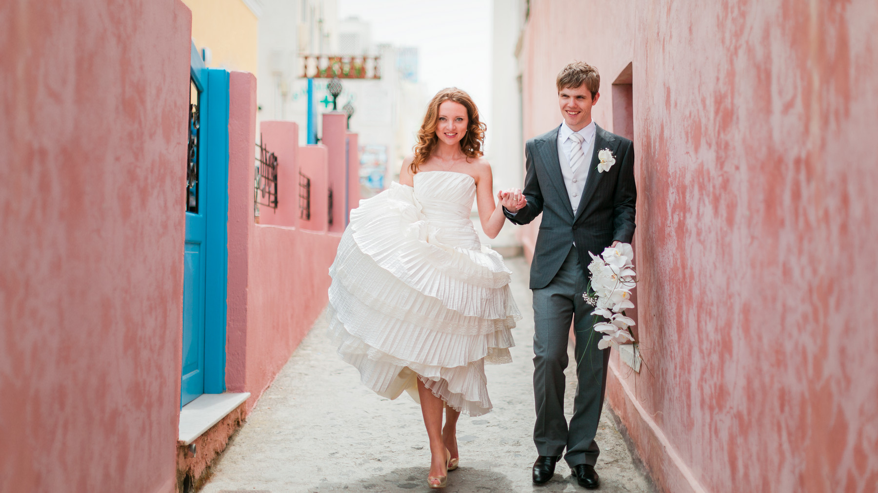 Portrait of groom and bride in ruffled strapless dress - photo by John and Joseph