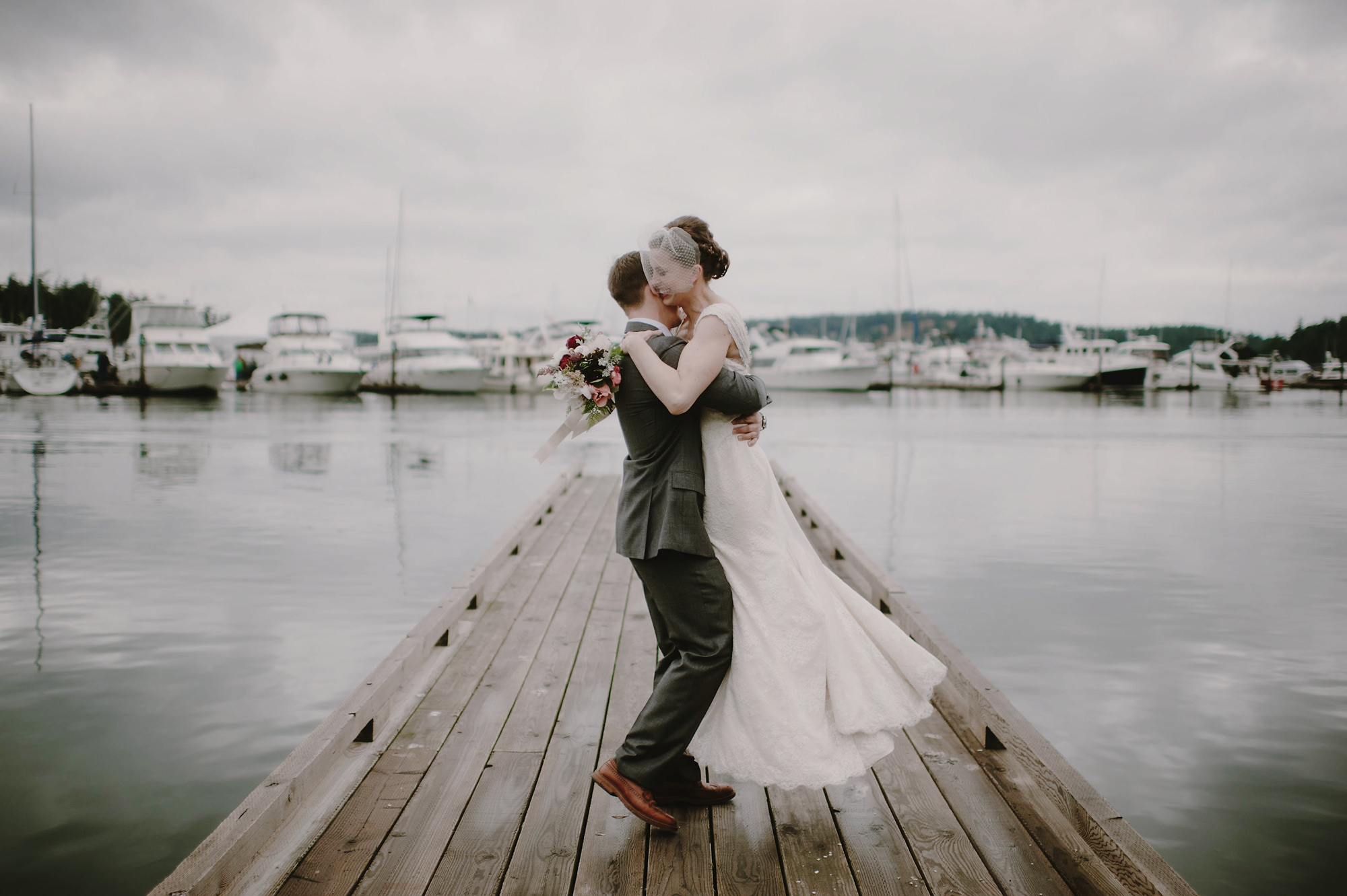Groom sweeps bride off feet at Marina - photo by Kristen Marie Parker
