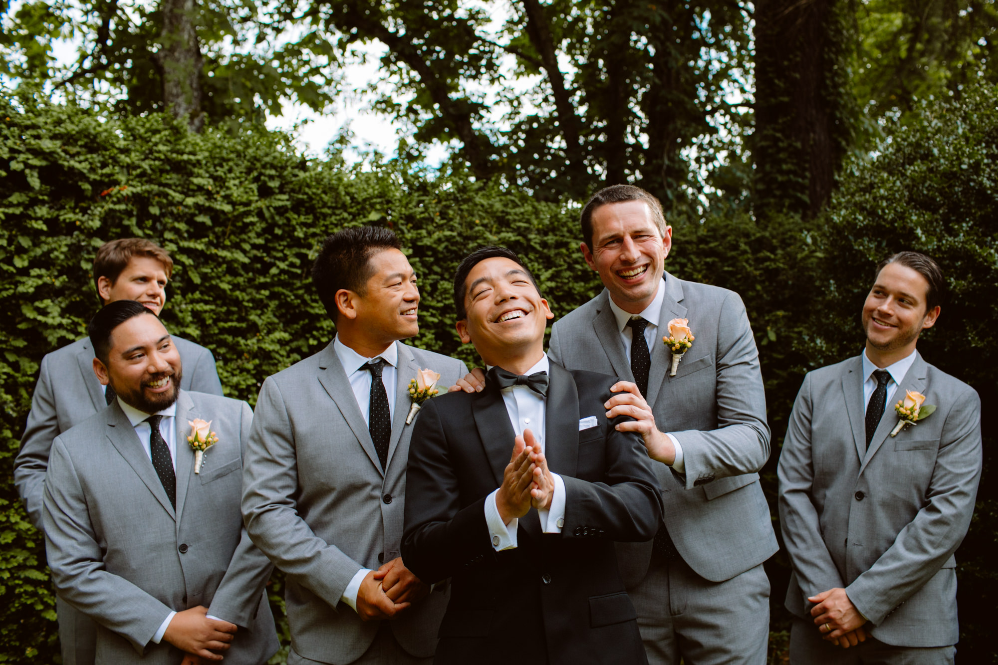 Happy  portrait of groom and groomsmen laughing - Jessica Hill Photography