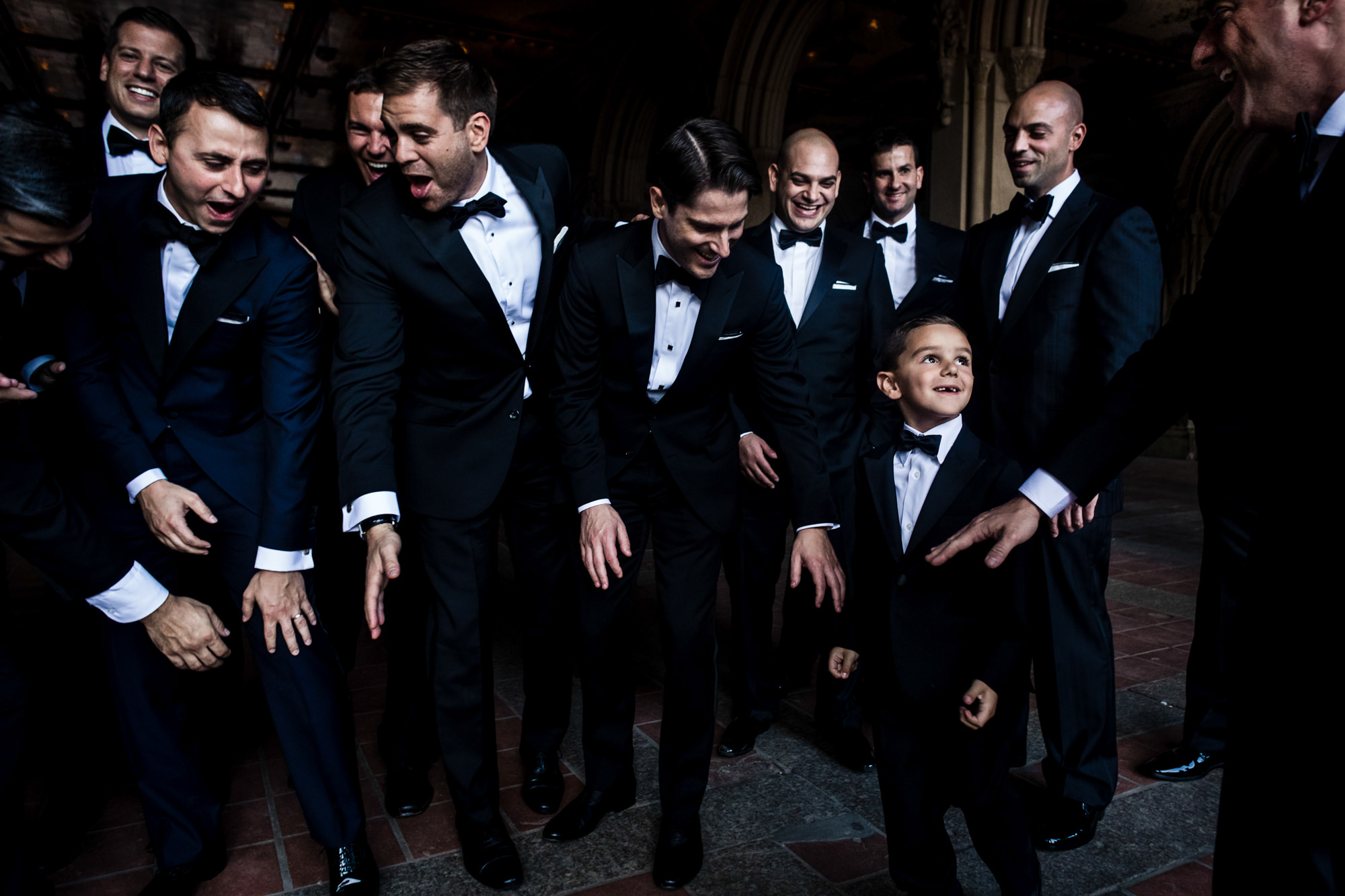 Groomsmen with little boy in tux - photo by Jag Studios