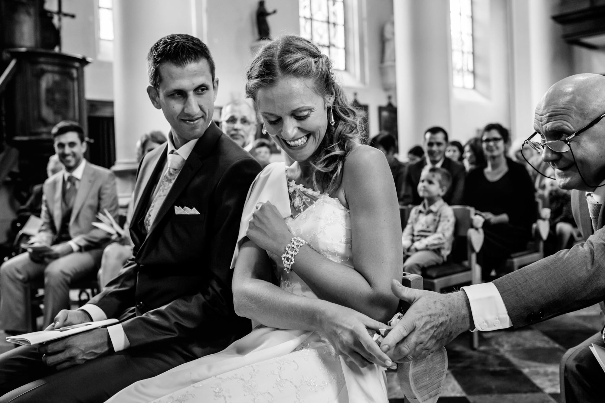 Guest passes bride a handkerchief during ceremony - photo by Phillipe Swiggers