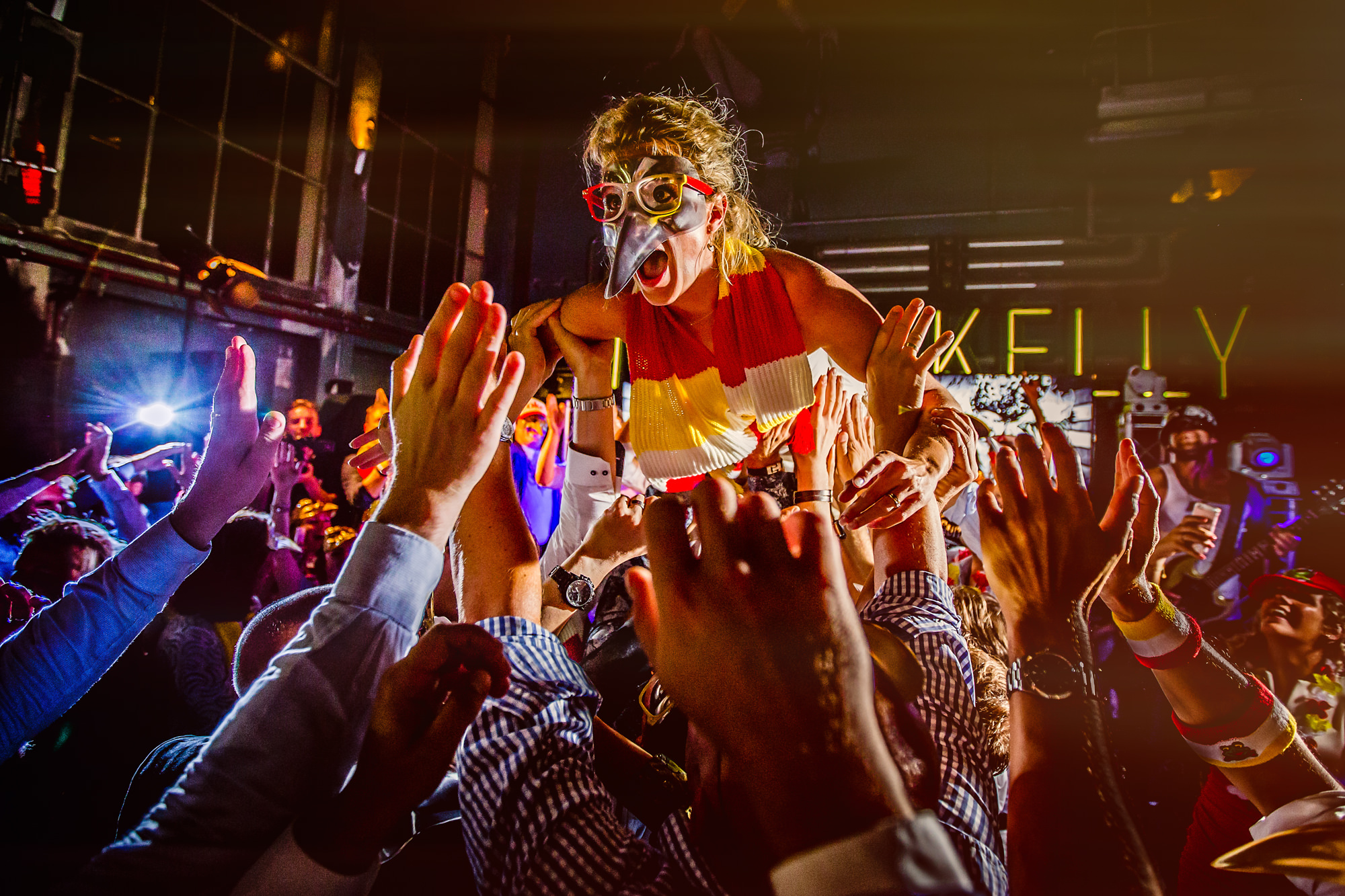 Guest in mosh pit wearing venetian mask by Eppel Photography Netherlands