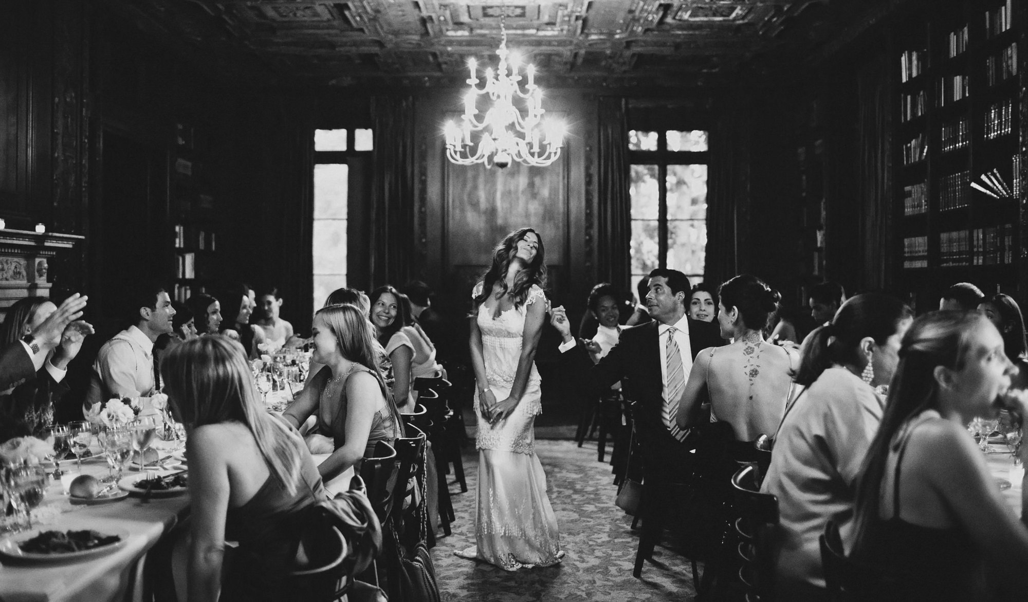 Guest touches bride walking past and posing - photo by Dan O'Day