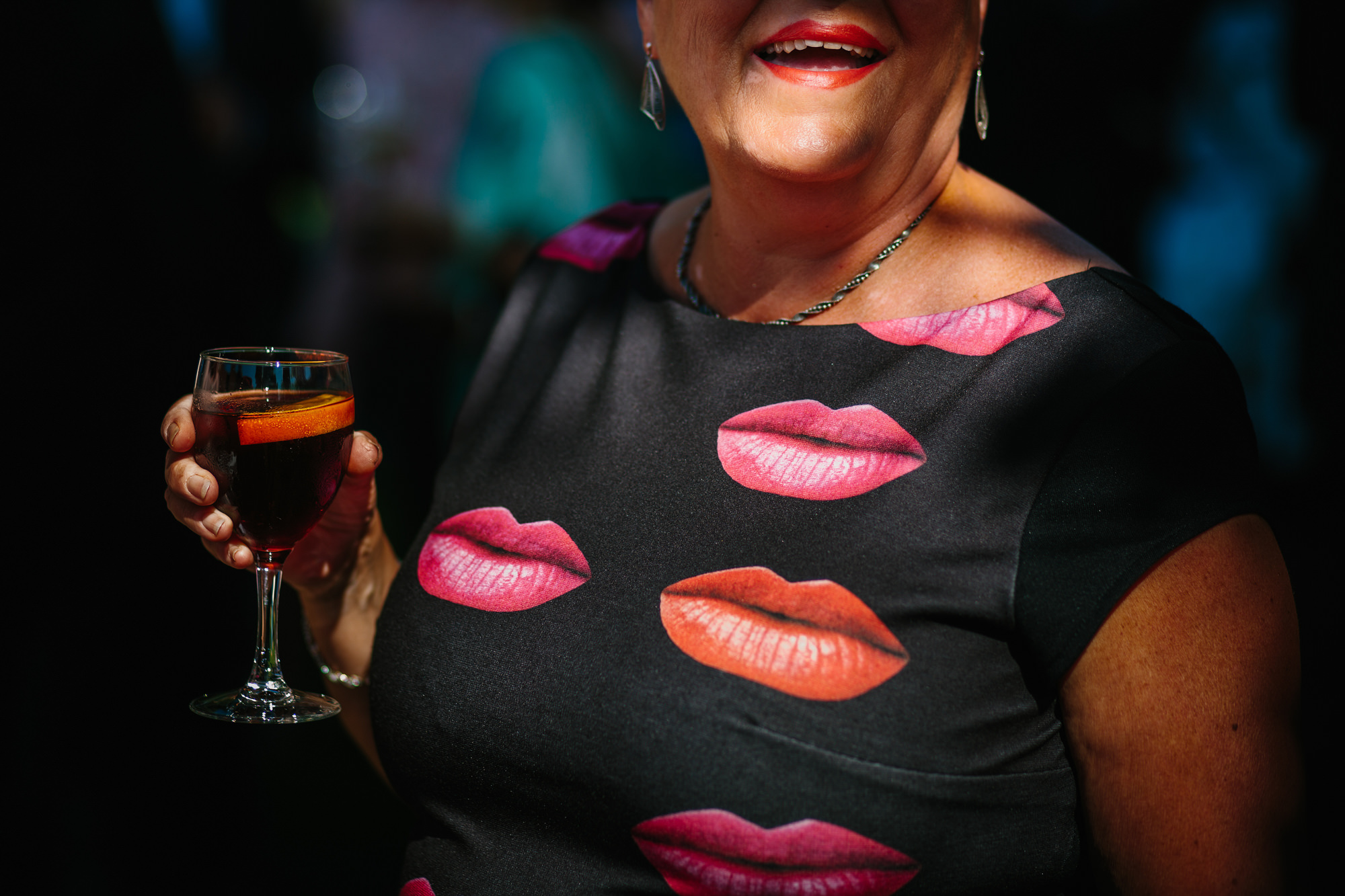 Guest with lips on dress, with red lips drinking red wine Yves Schepers Belgium wedding photographers