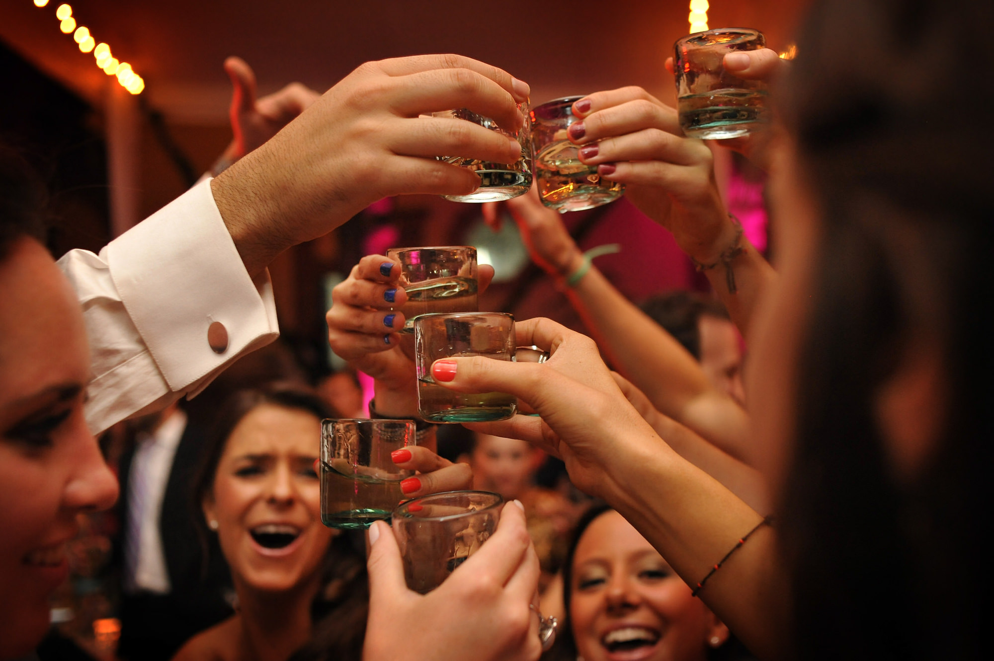 Party toast with shot glasses  - Daniel Aguilar Photographer
