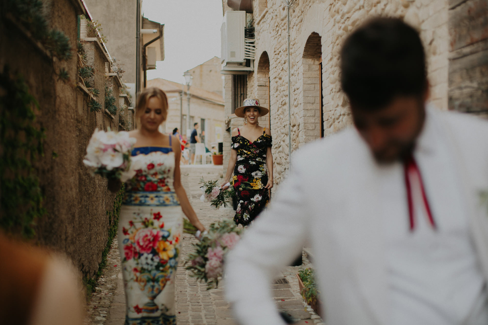 Guests in floral dresses in Mexican street -  photo by Dan O'Day