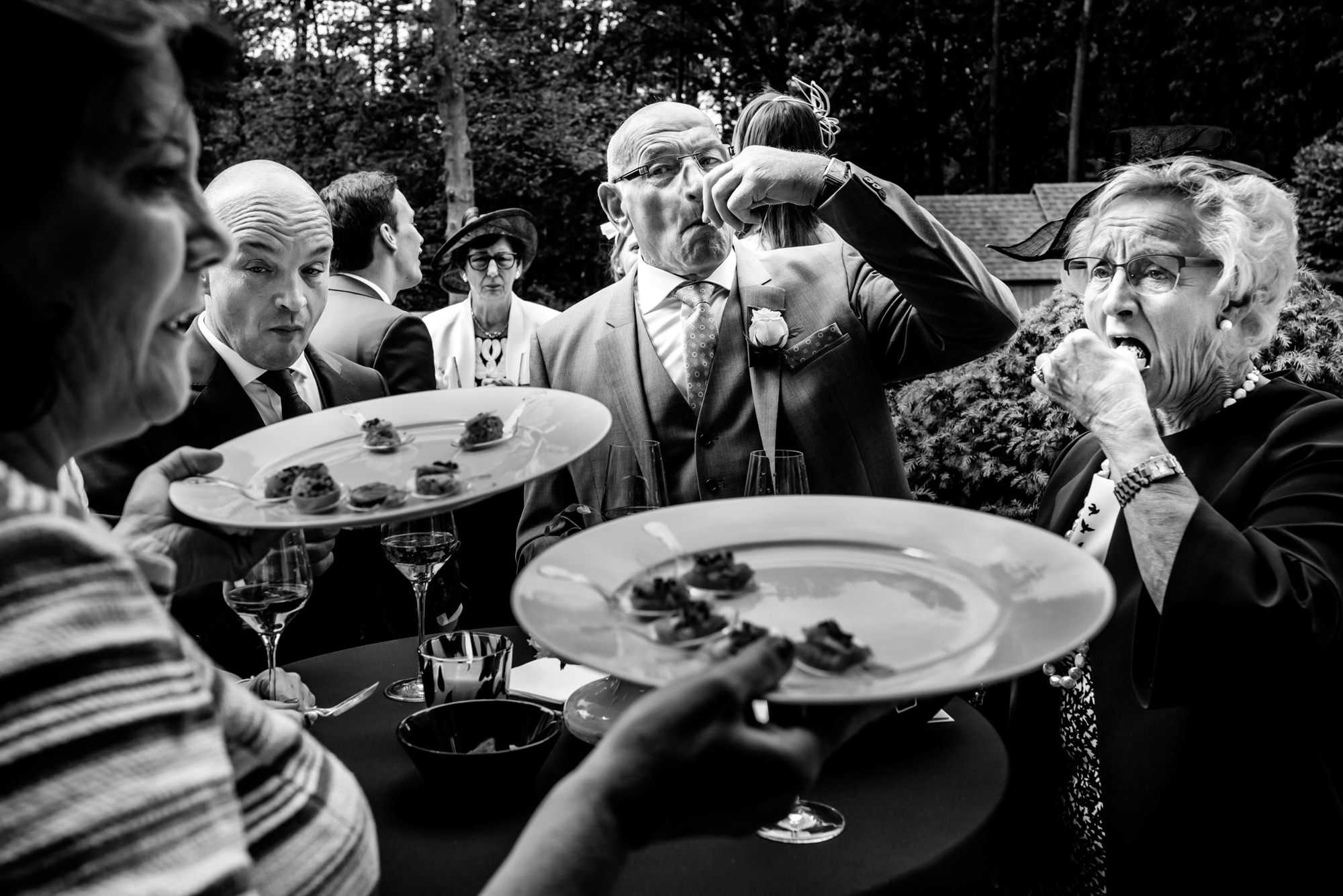 Guest eating canapes - photo by Phillipe Swiggers