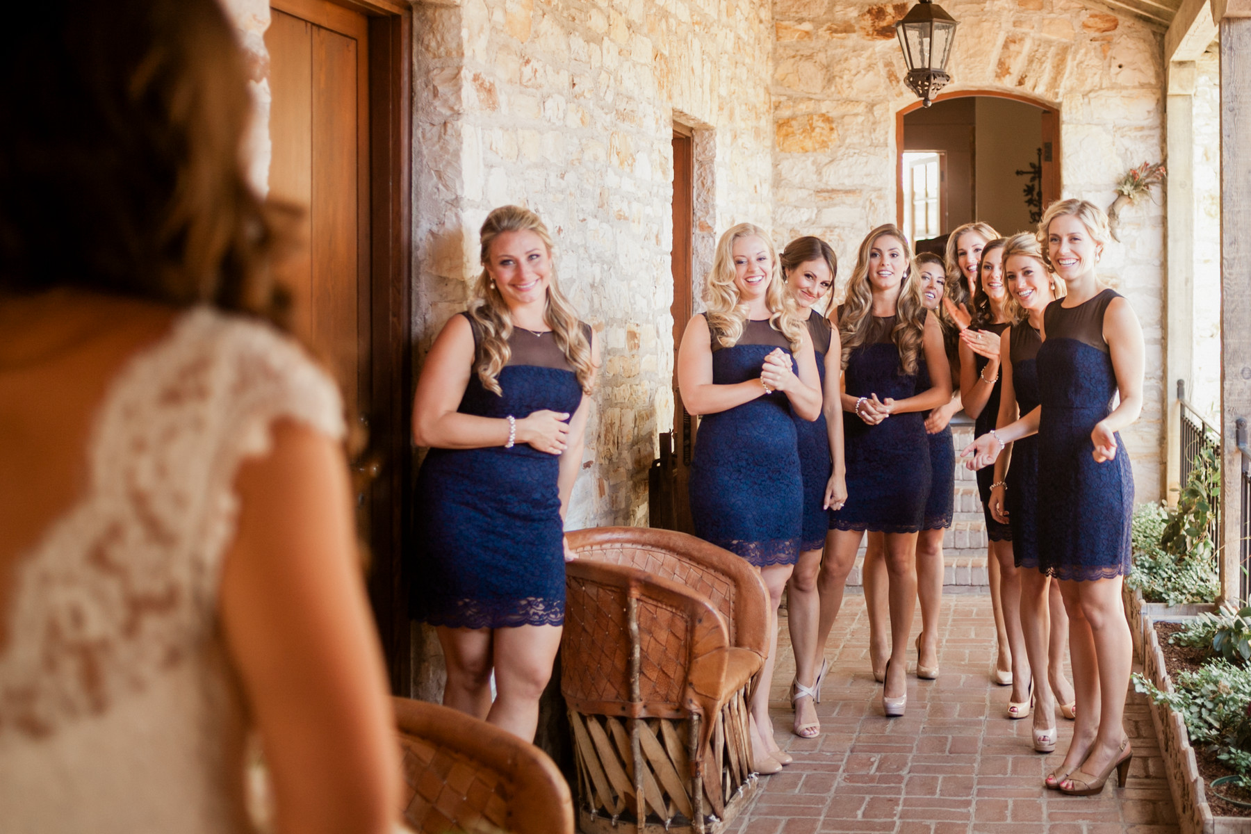 Bridesmaid in blue short knee length dresses welcome bride - photo by John and Joseph - Los Angeles