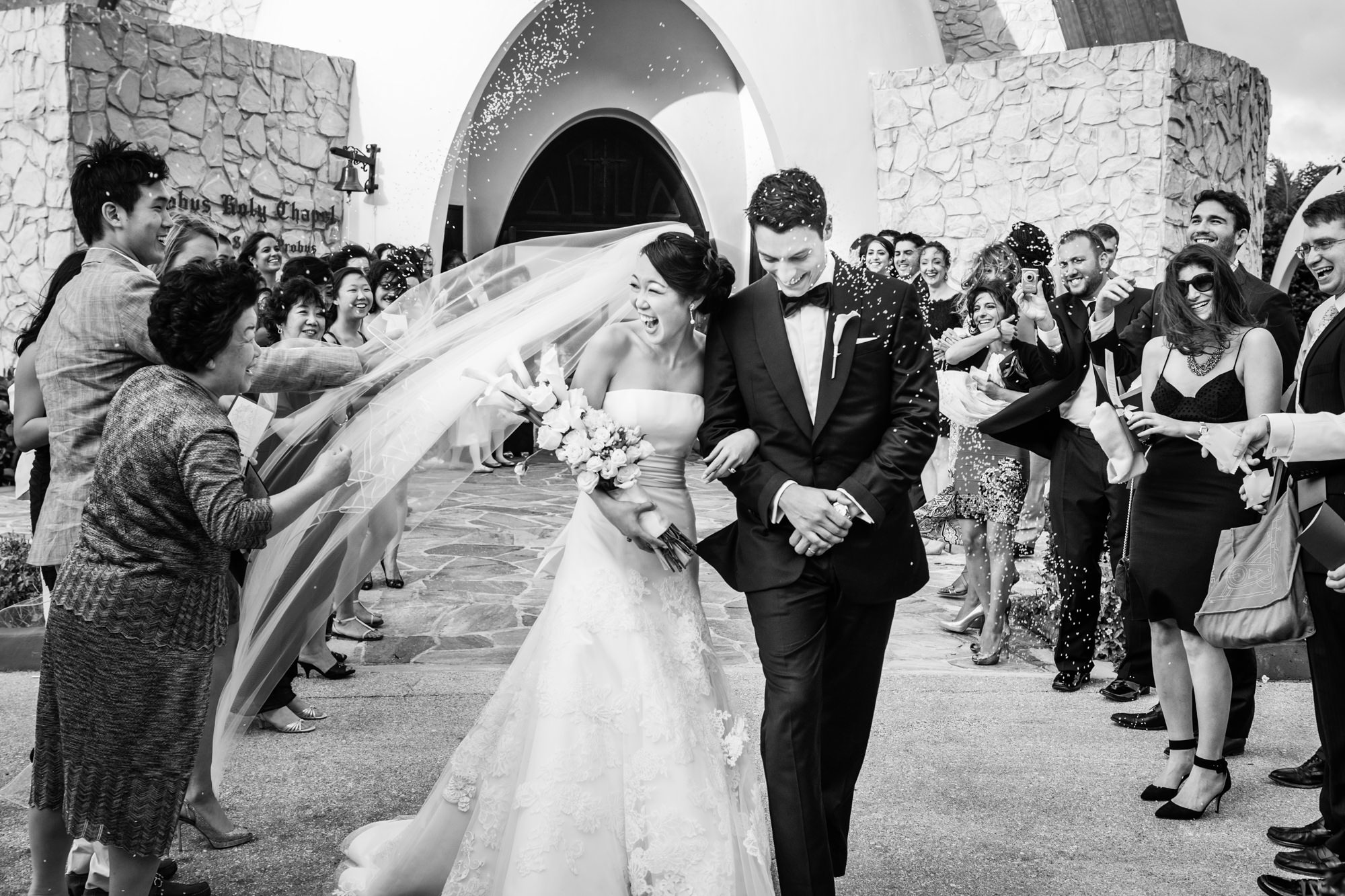 Happy just married couple leaving church -  Studio Impressions Photography