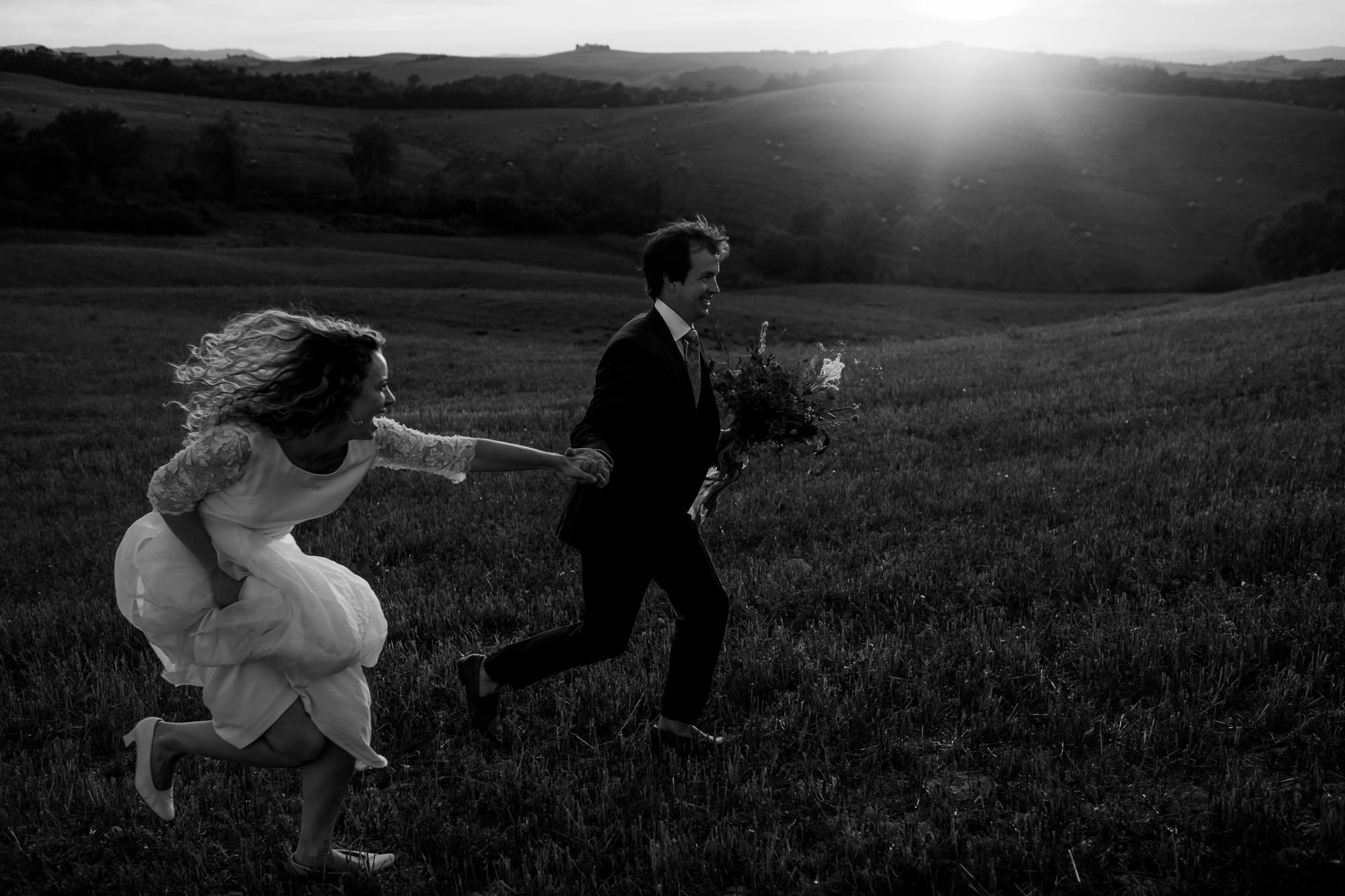 Happy couple run with champagne photo by Nordica Photography