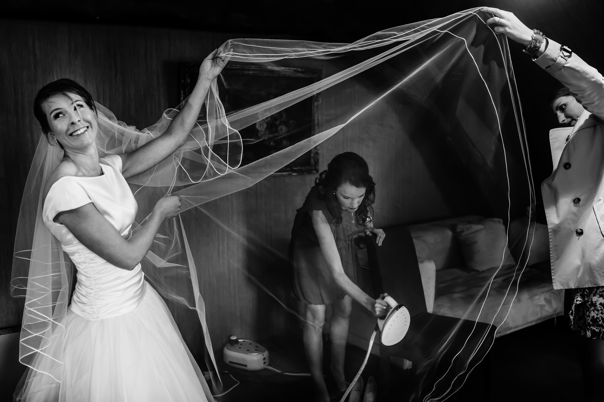 Happy and relaxed bride getting her veil steamed Yves Schepers Belgium wedding photographer
