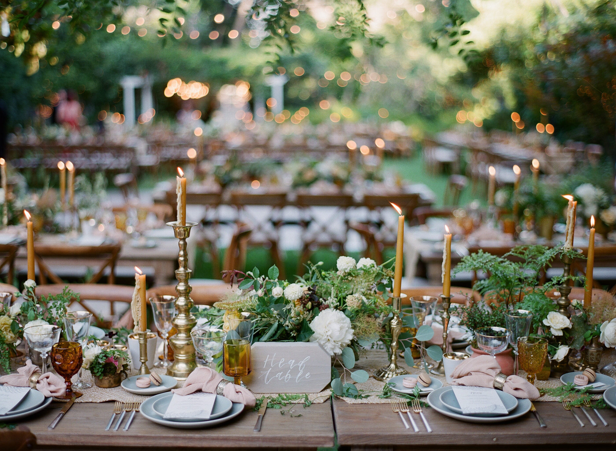 Rustic and elegant reception with wood table and brass candlesticks - Greg Finck Photography