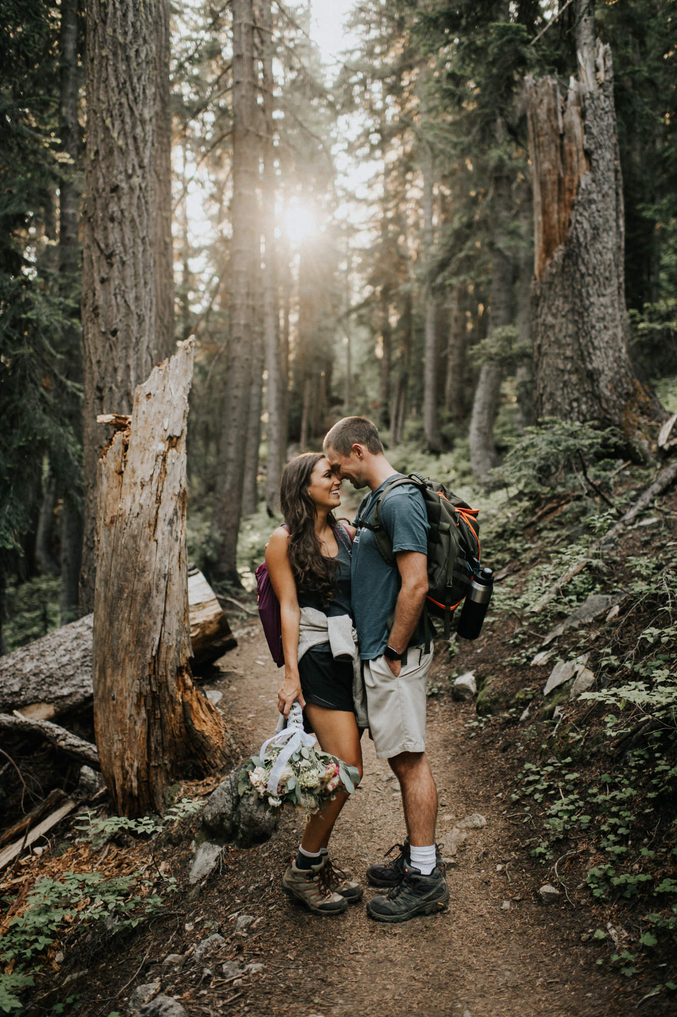 Couple kisses on the trail - Nick + Danee