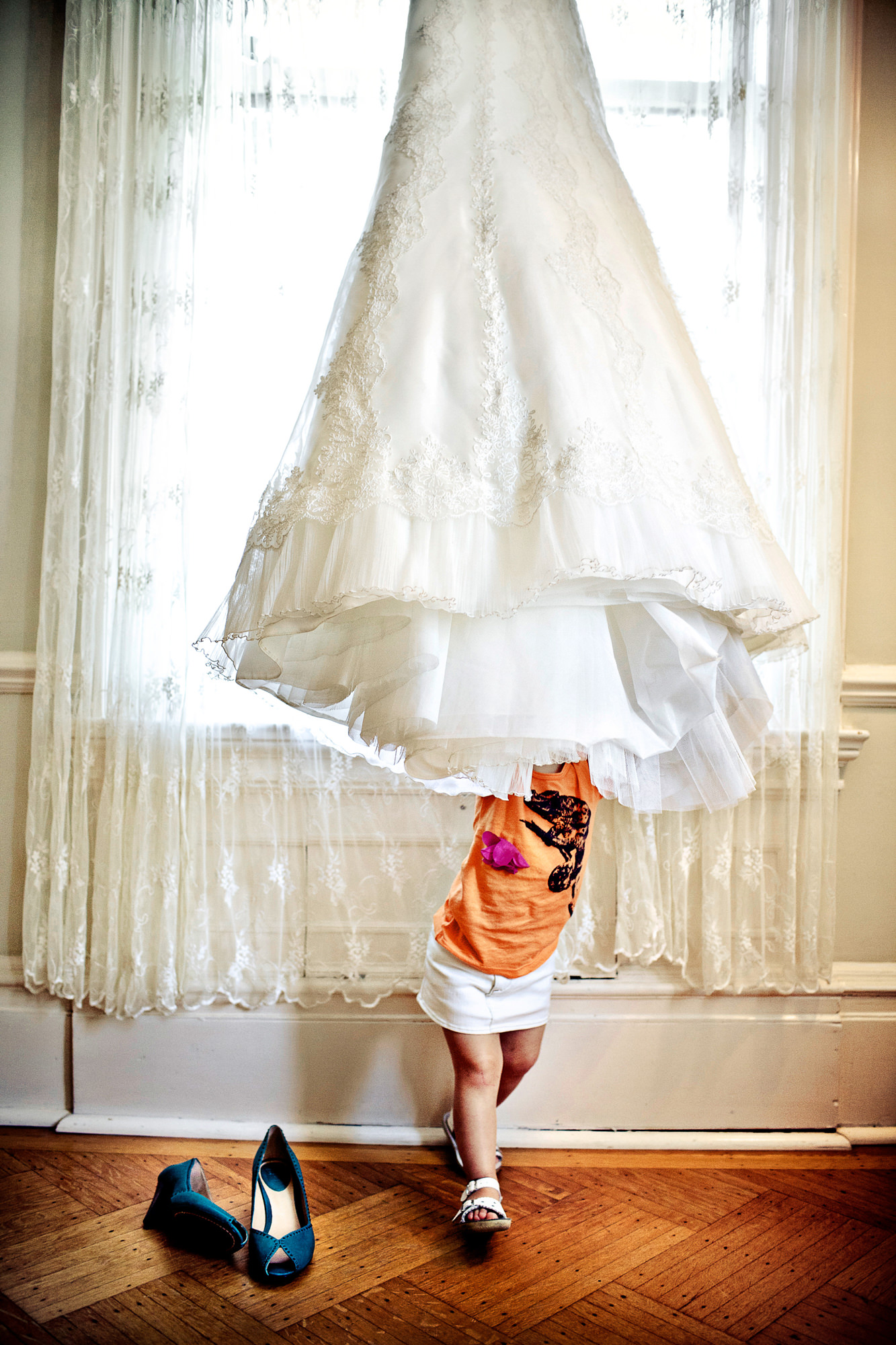 Hilarious kid under bridal gown - photo by Jag Studios