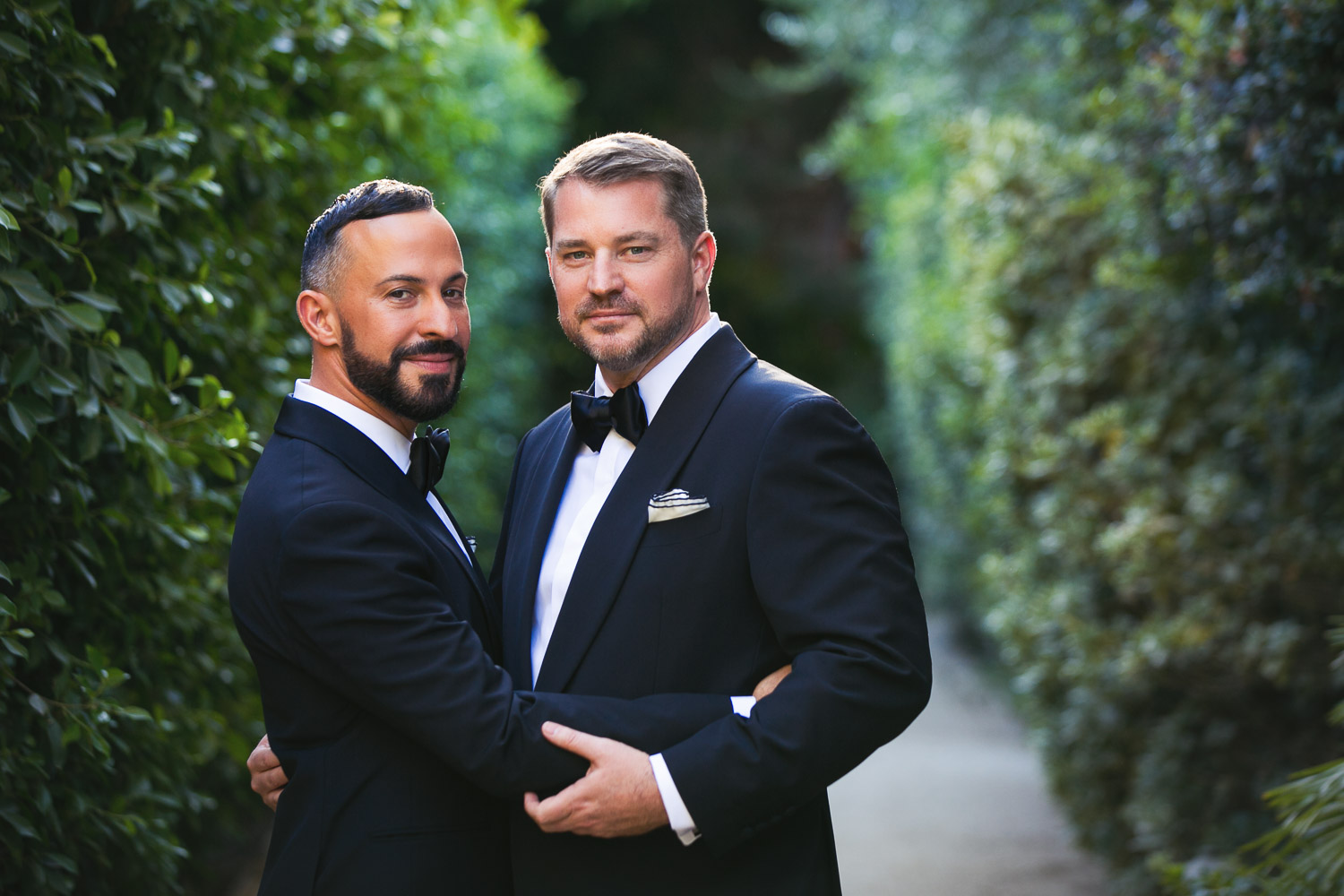 Groom embrace wearing tuxedos and bowtie - photo by Callaway Gable - Los Angeles