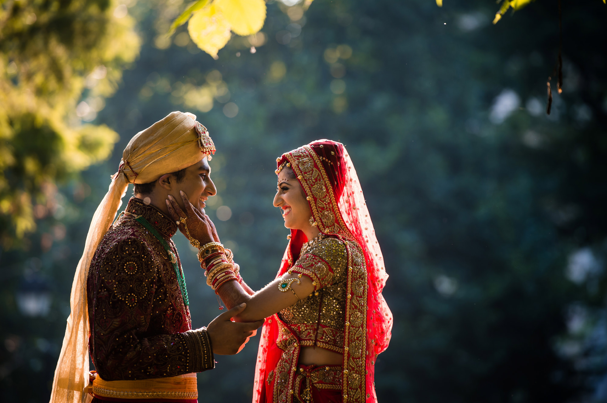 Indian bride and groom embracing photo by Cliff Mautner