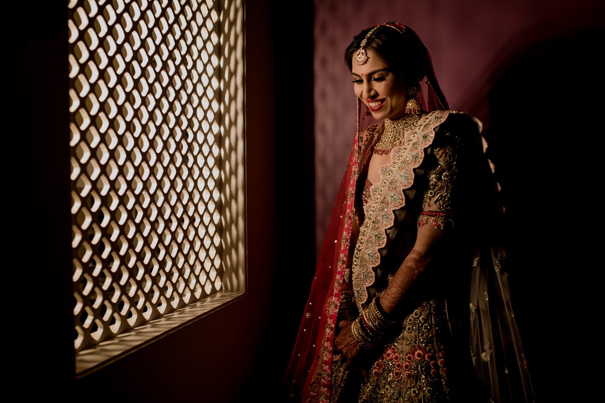 Indian bride at window - photo by Rimi Sen Photography