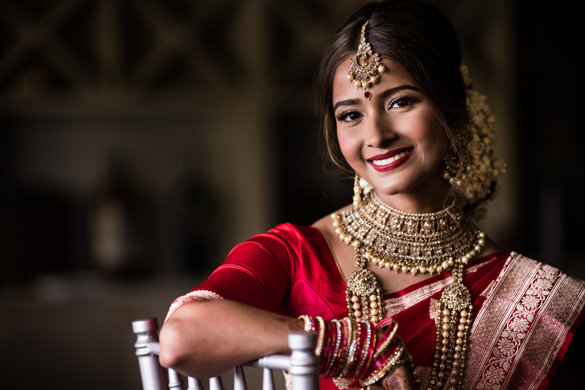 Smiling Indian bride in red traditional photo by Cliff Mautner
