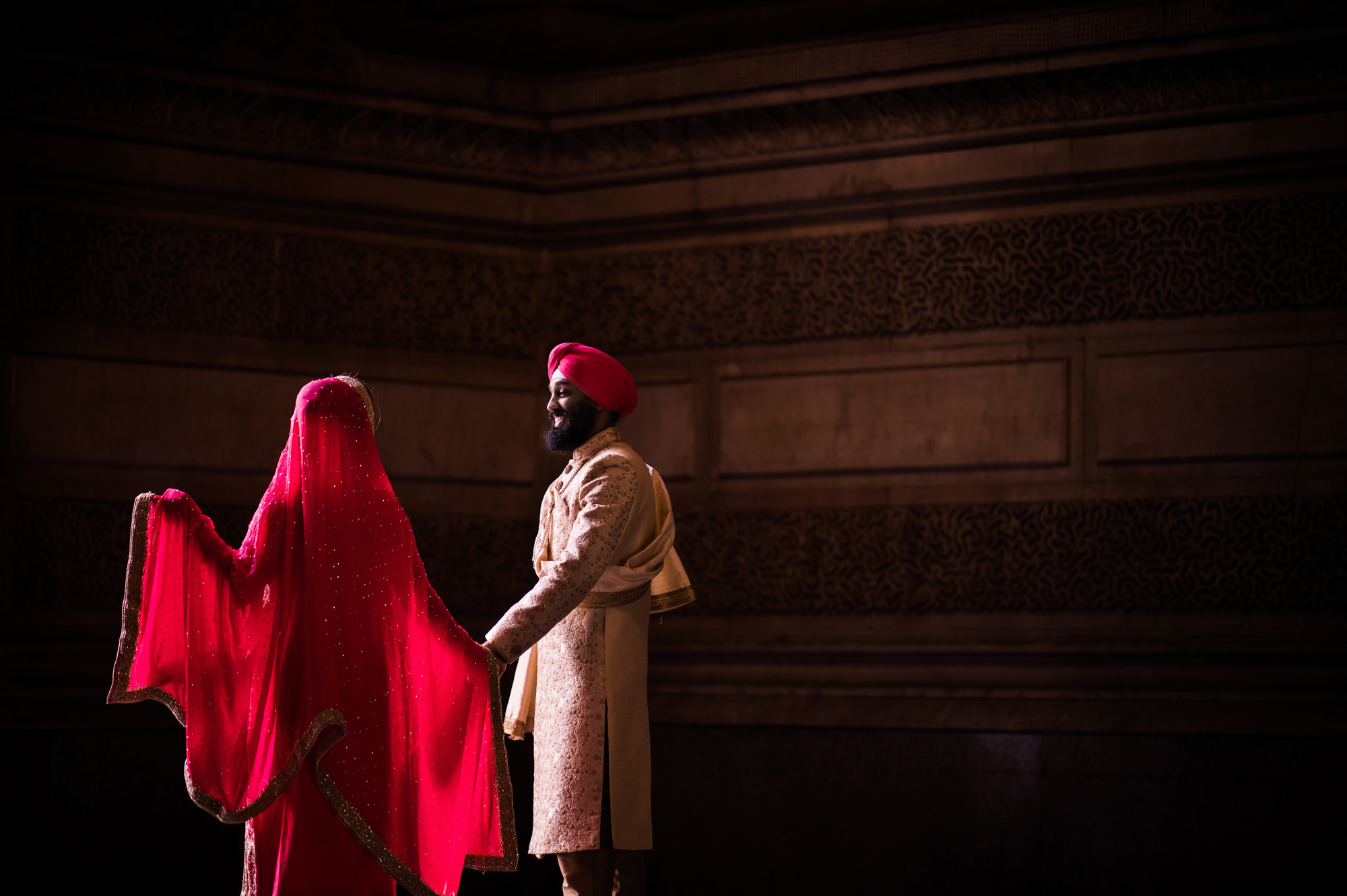 Indian couple in red photo by Cliff Mautner