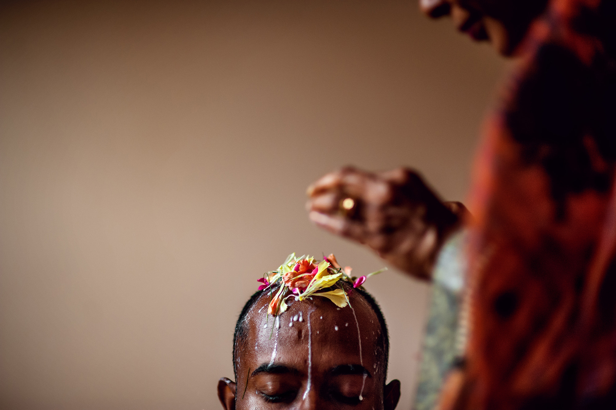 Indian groom head decorated with florals and milk - photo by Davina + Daniel