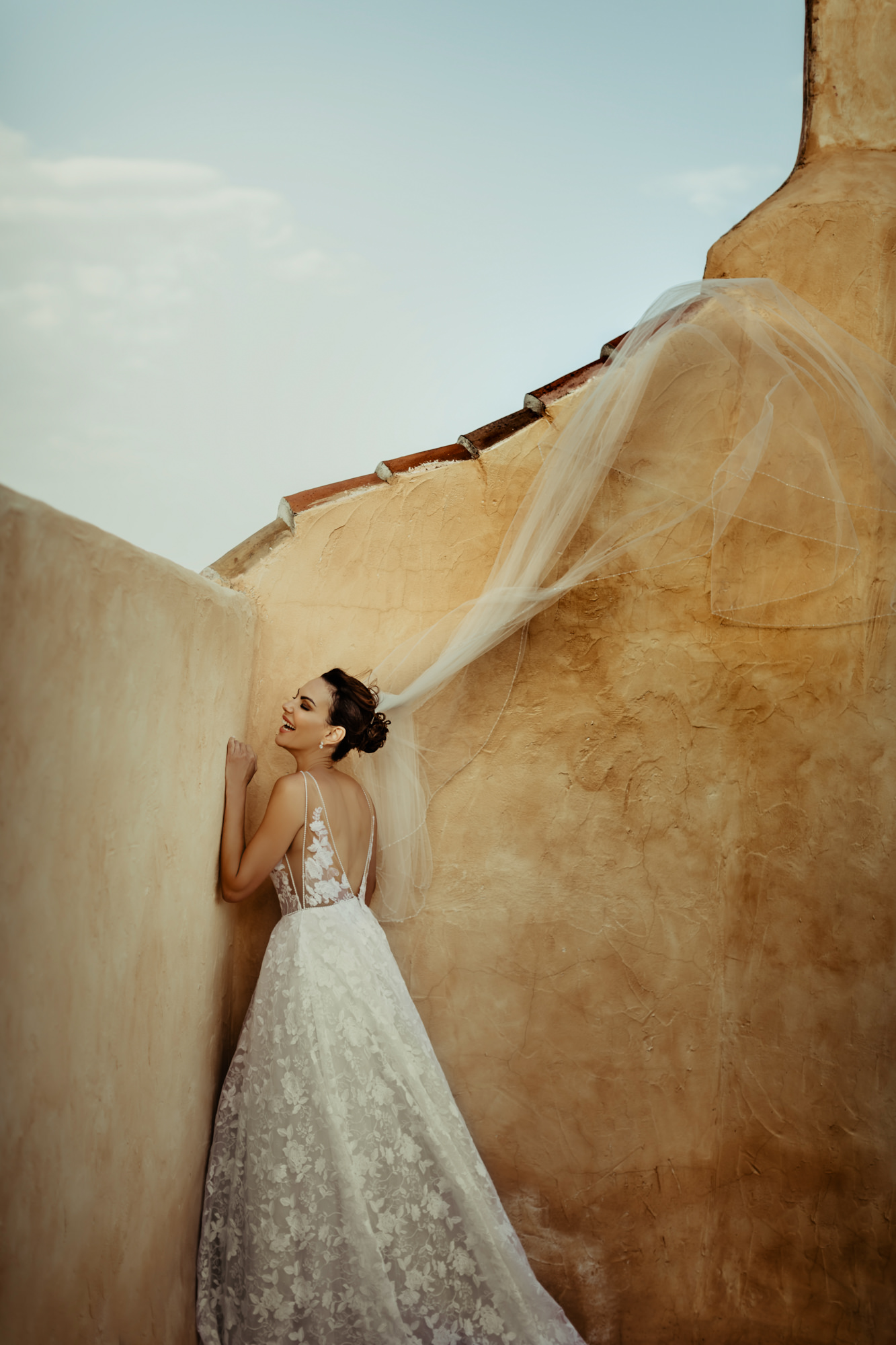Bride with flying veil photo by David Bastianoni