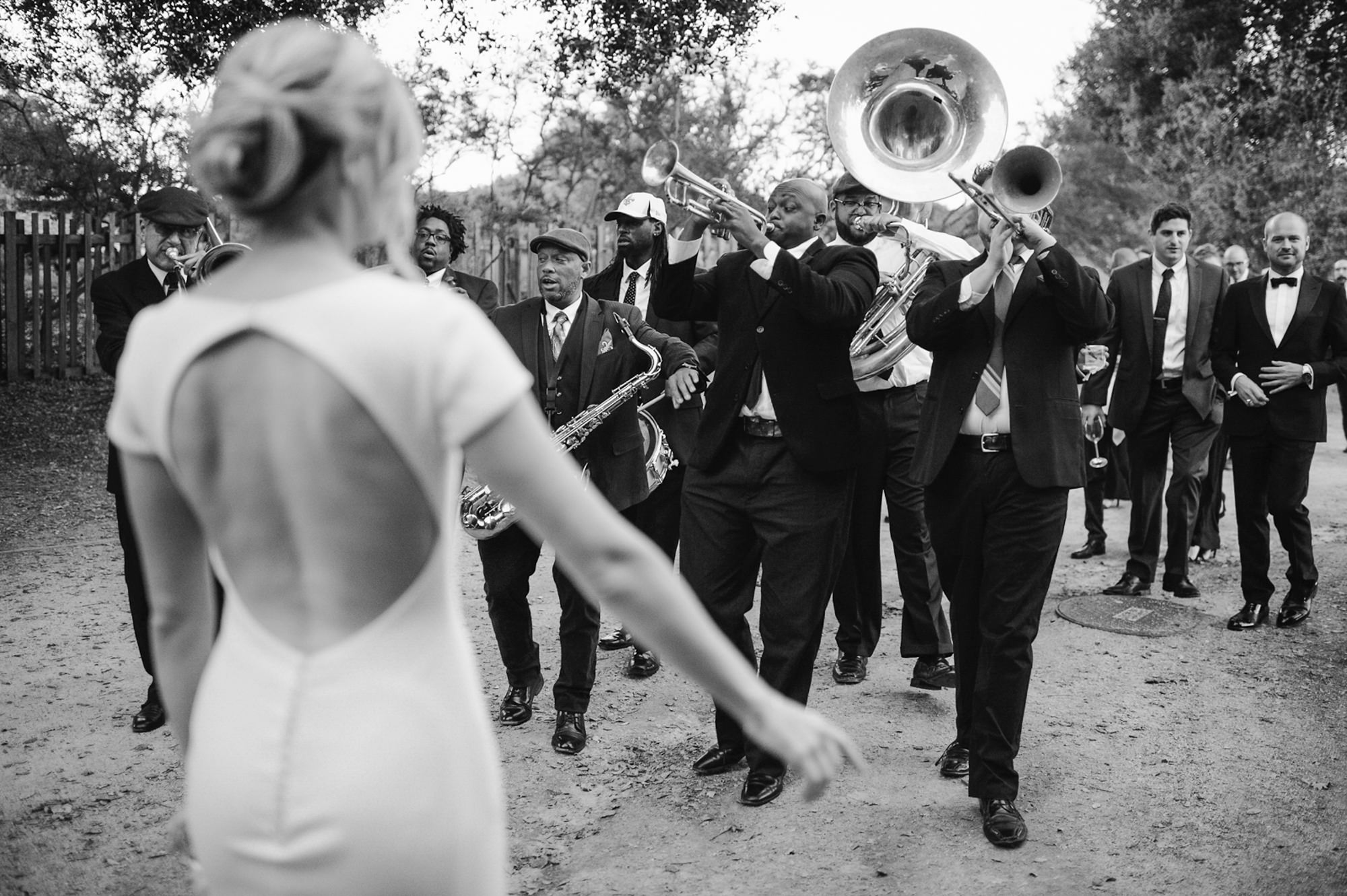 Jazz band approaches bride  - photo by Kristen Marie Parker